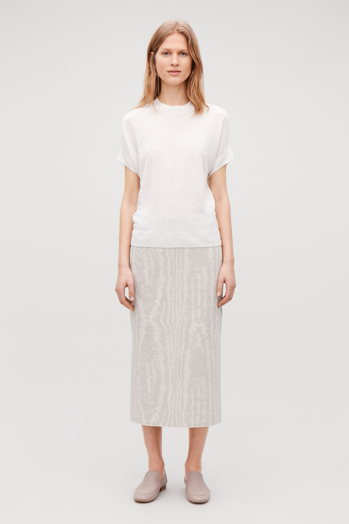 Model front image of Cos moire jacquard-knit skirt in beige