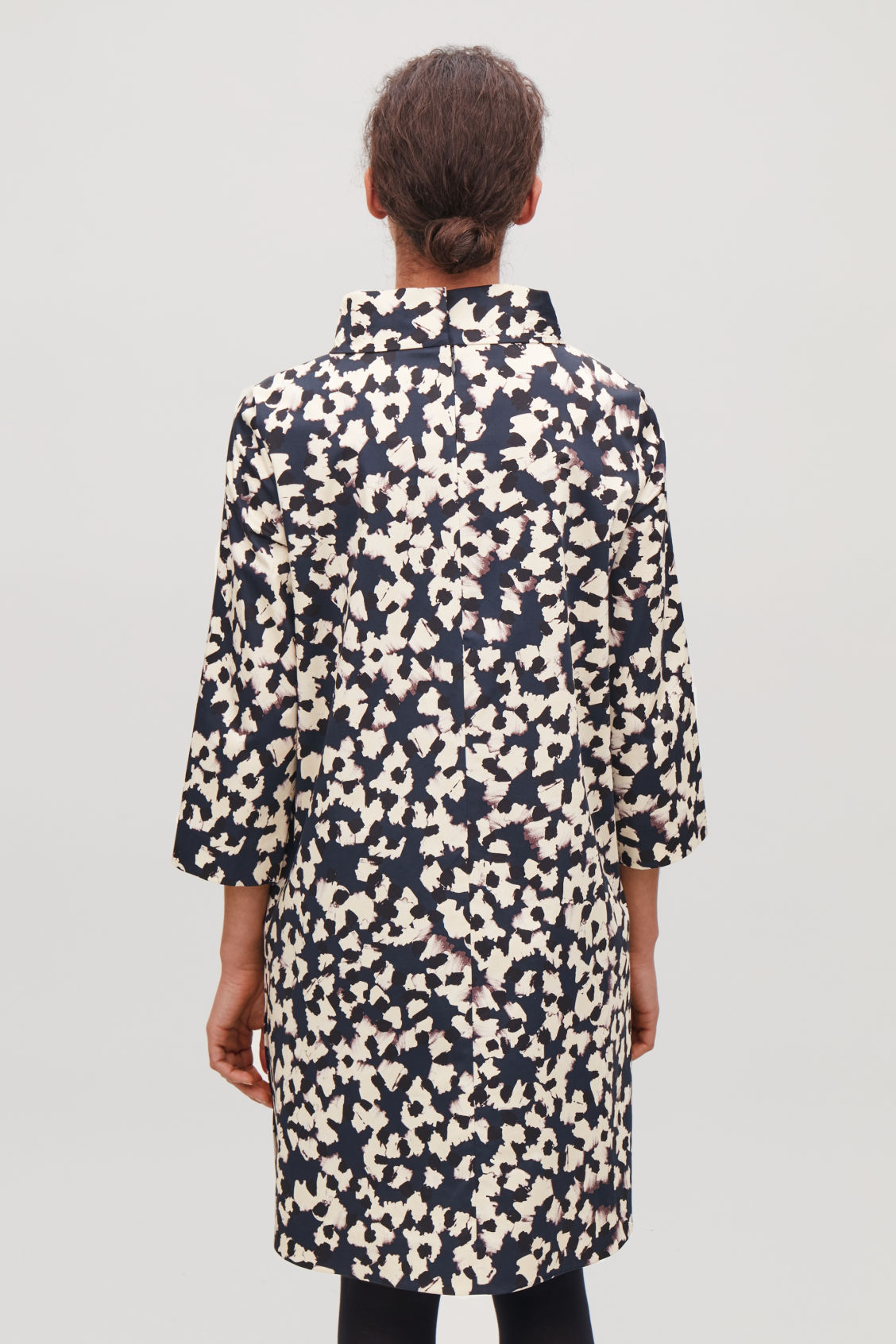 Model side image of Cos stand-up collar printed dress in blue
