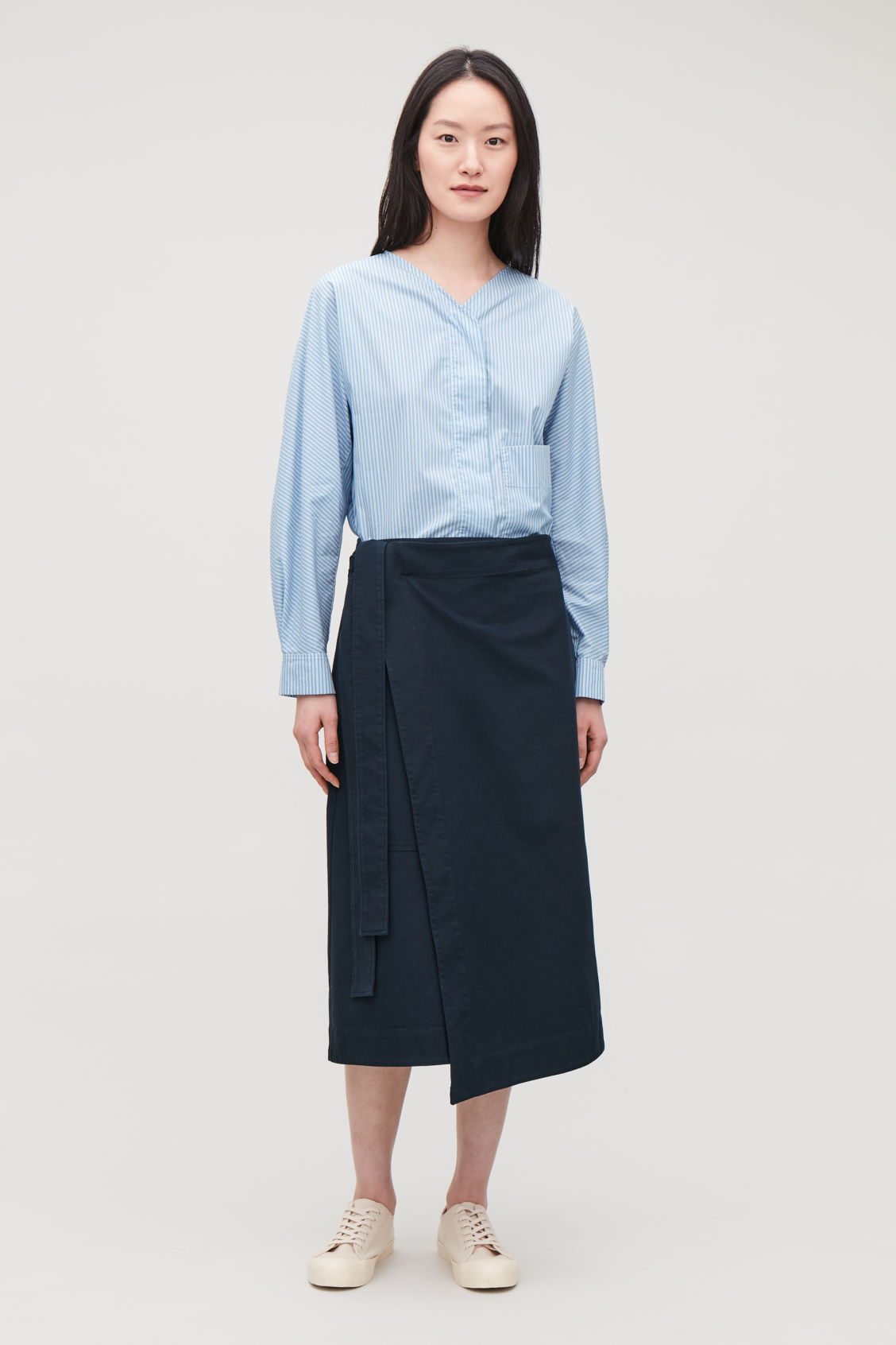Model front image of Cos belted wrap skirt in blue