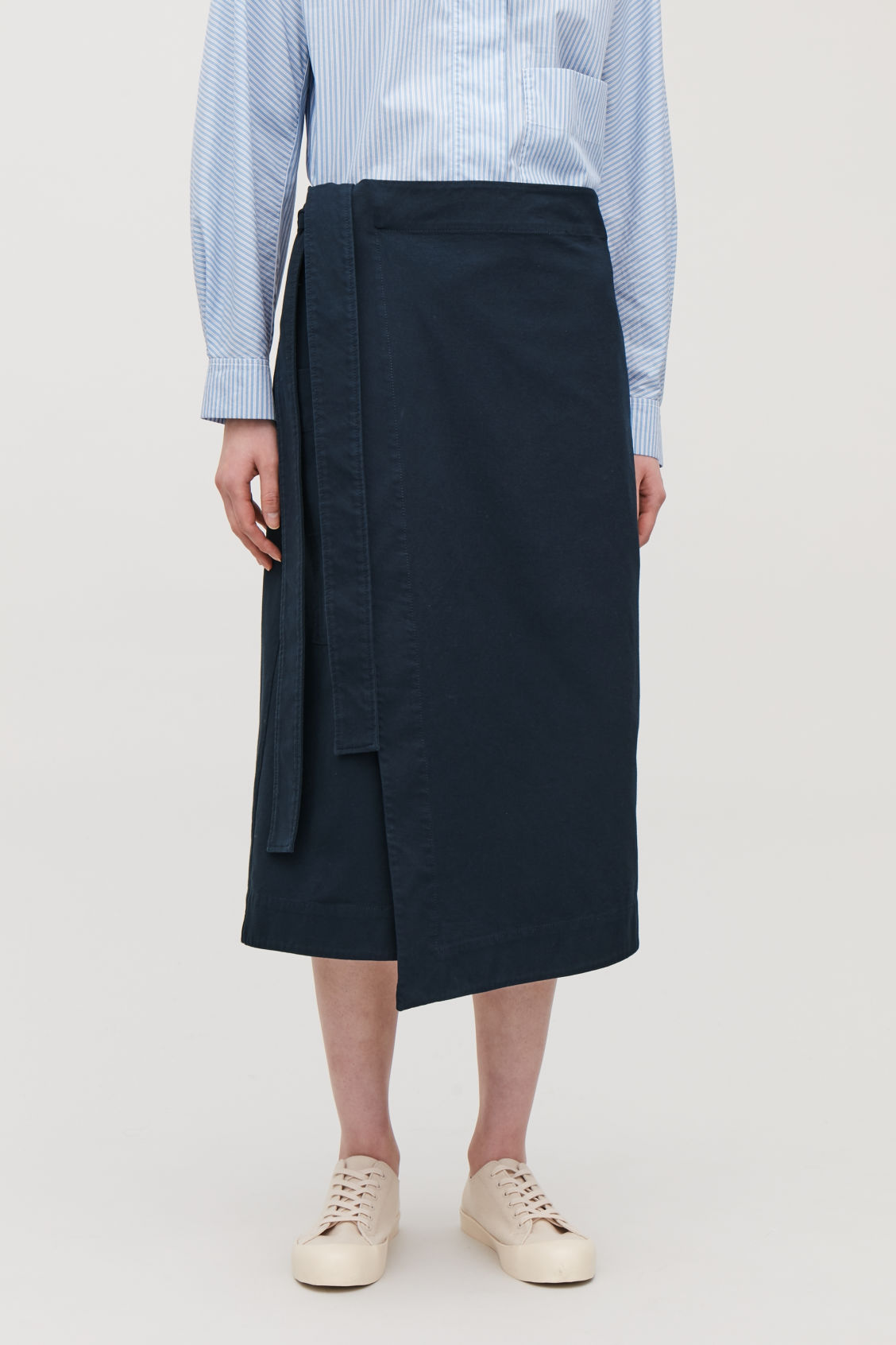Model side image of Cos belted wrap skirt in blue