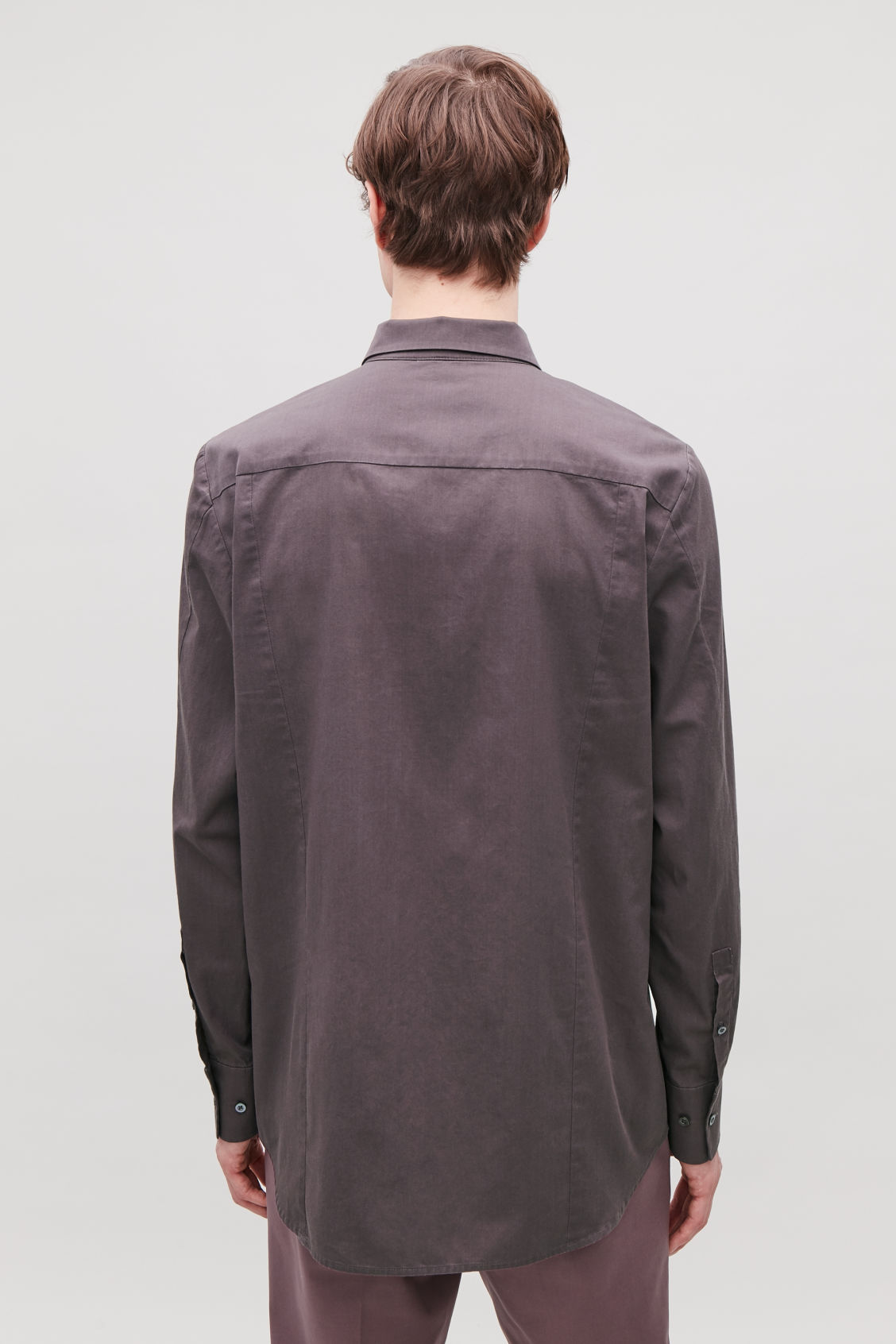 Model side image of Cos cotton shirt with seam detailing in purple