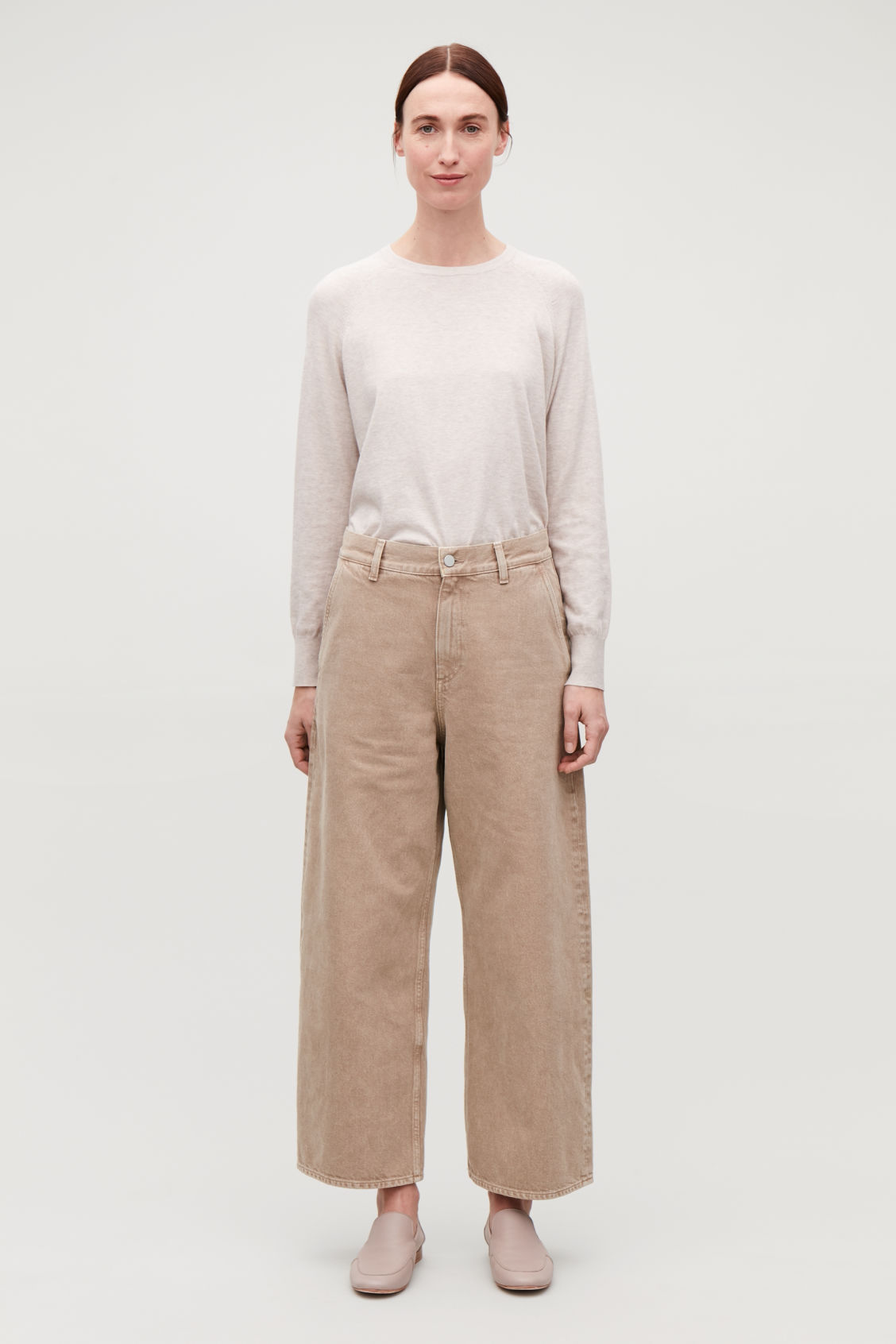 Model front image of Cos  in beige