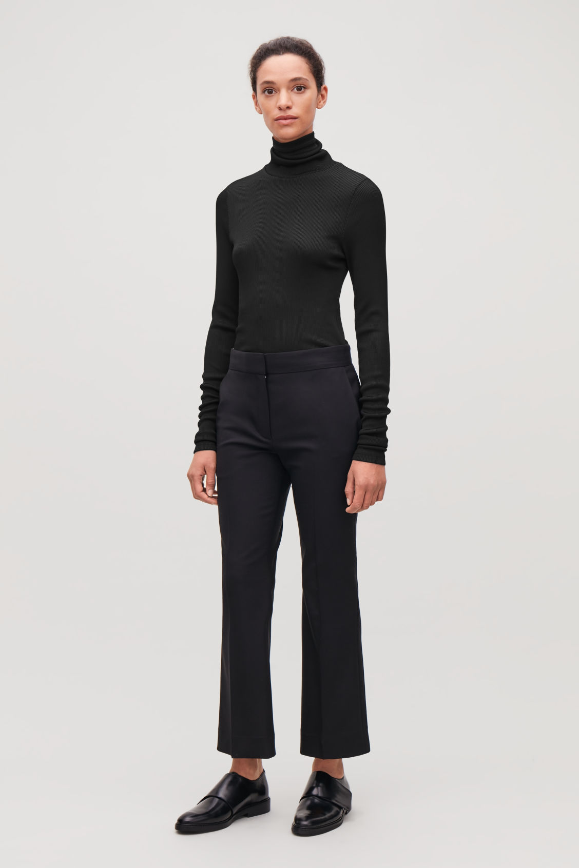 Model front image of Cos ribbed high-neck jersey top in black 624f6d499