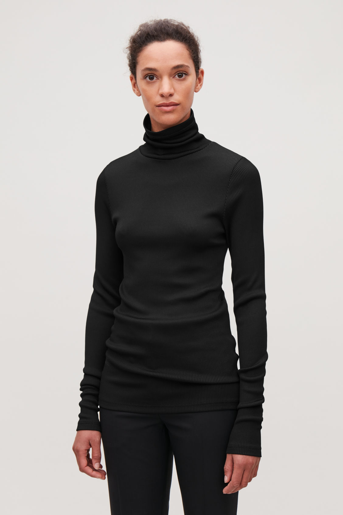 Model side image of Cos ribbed high-neck jersey top in black