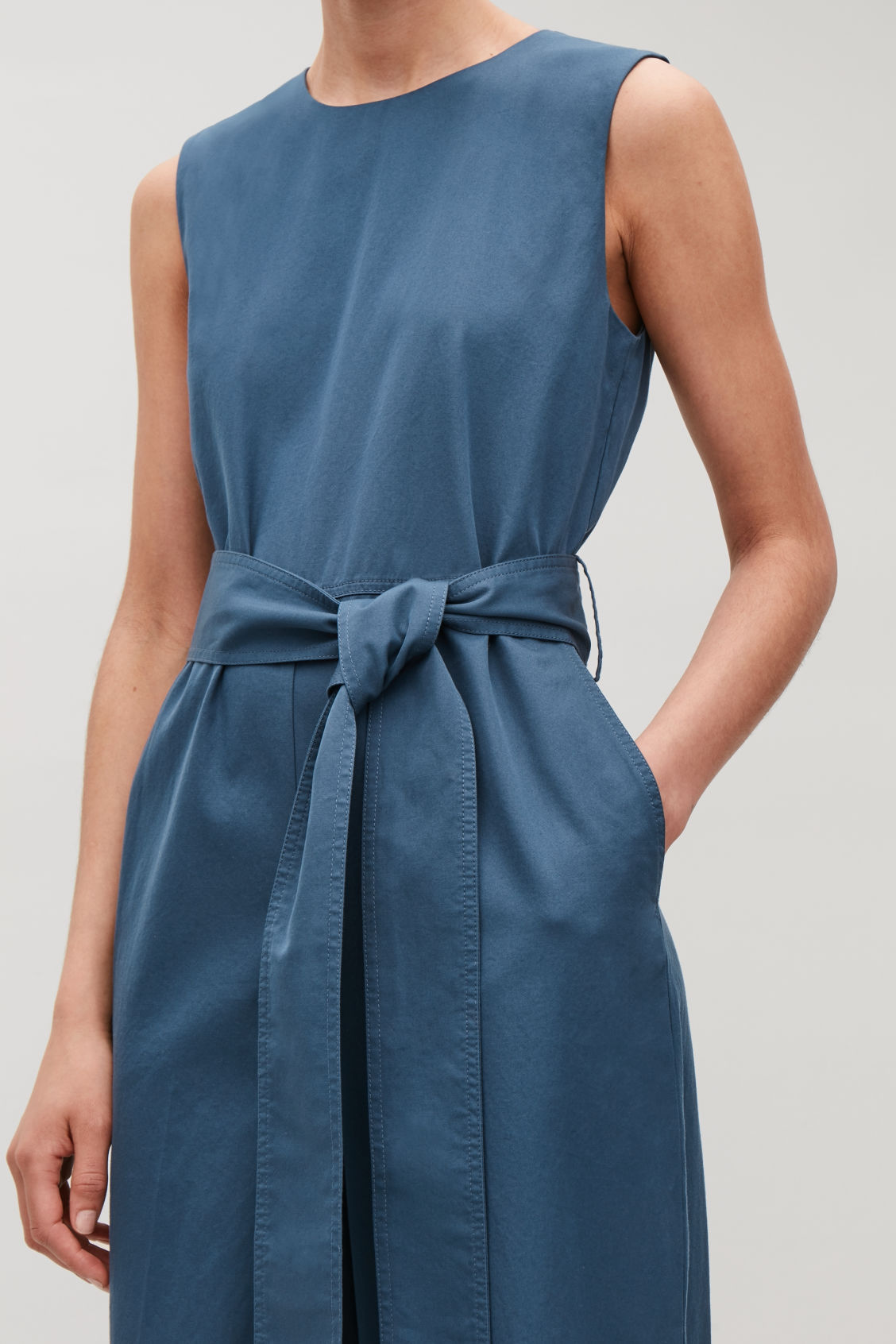 Model side image of Cos belted wide-leg jumpsuit in blue