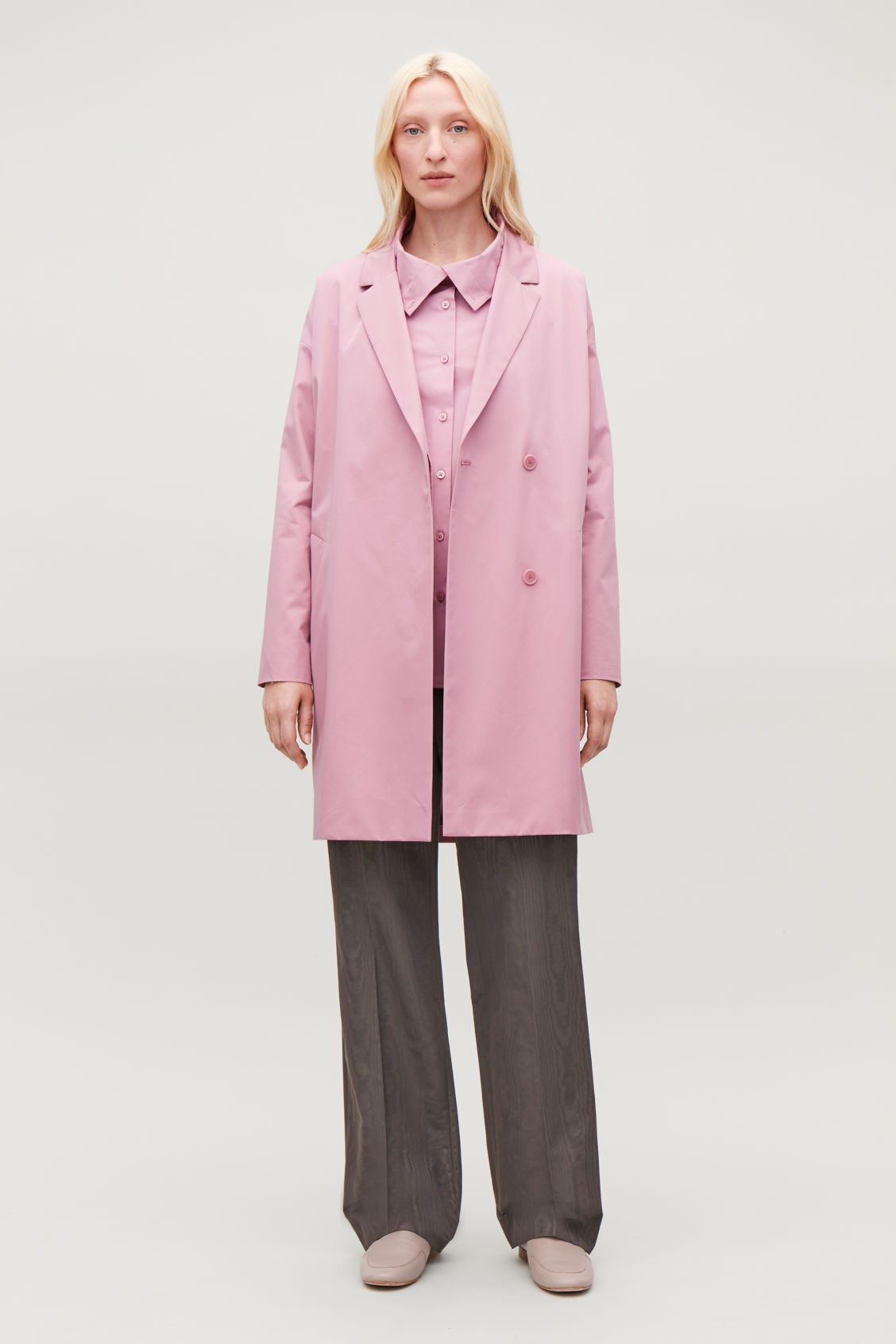Model side image of Cos oversized blazer-style coat in pink