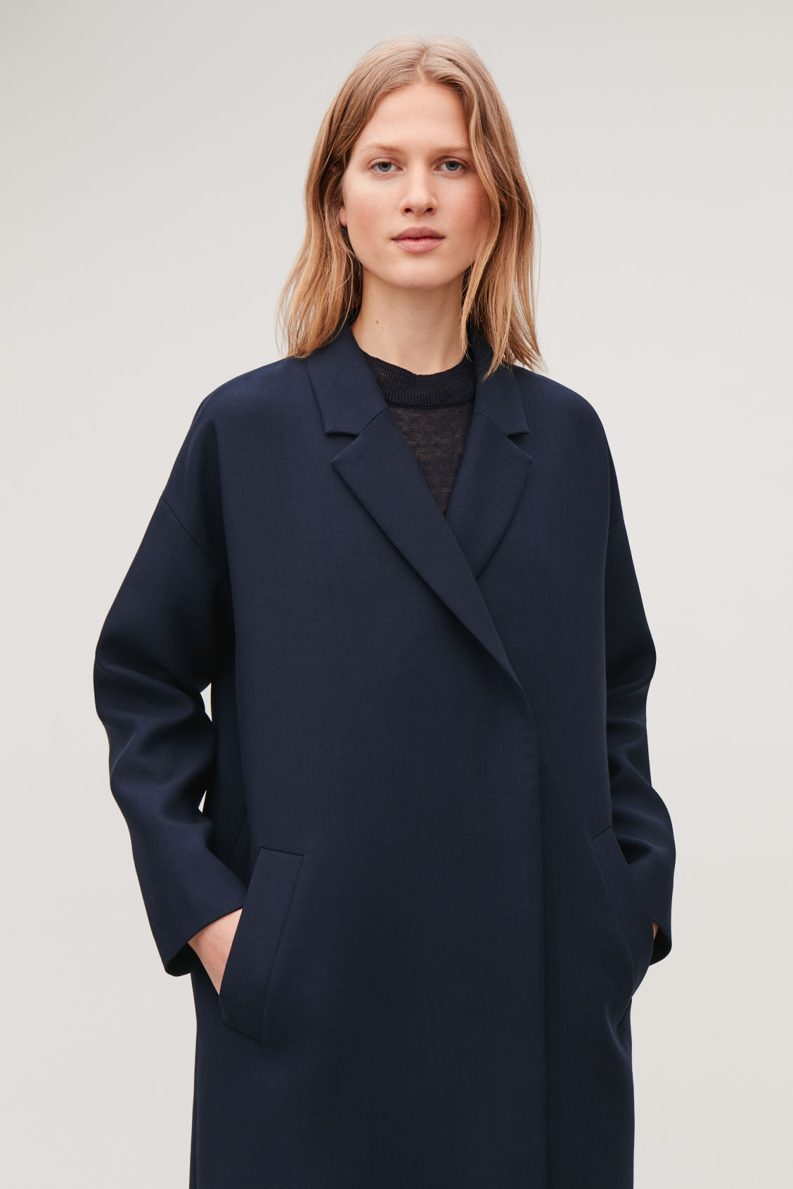 Model side image of Cos blazer-style wool coat in blue
