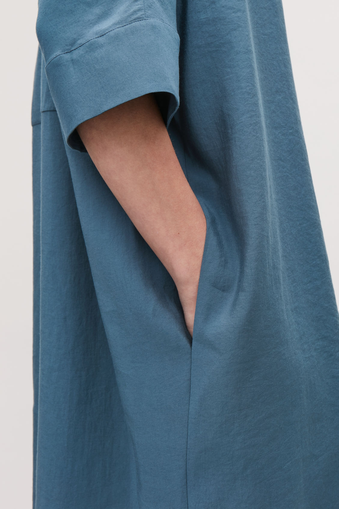 Model side image of Cos crinkled woven shirt dress in blue