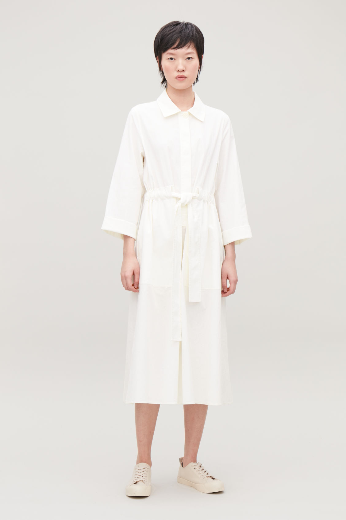 Model front image of Cos belted poplin shirt dress in cream