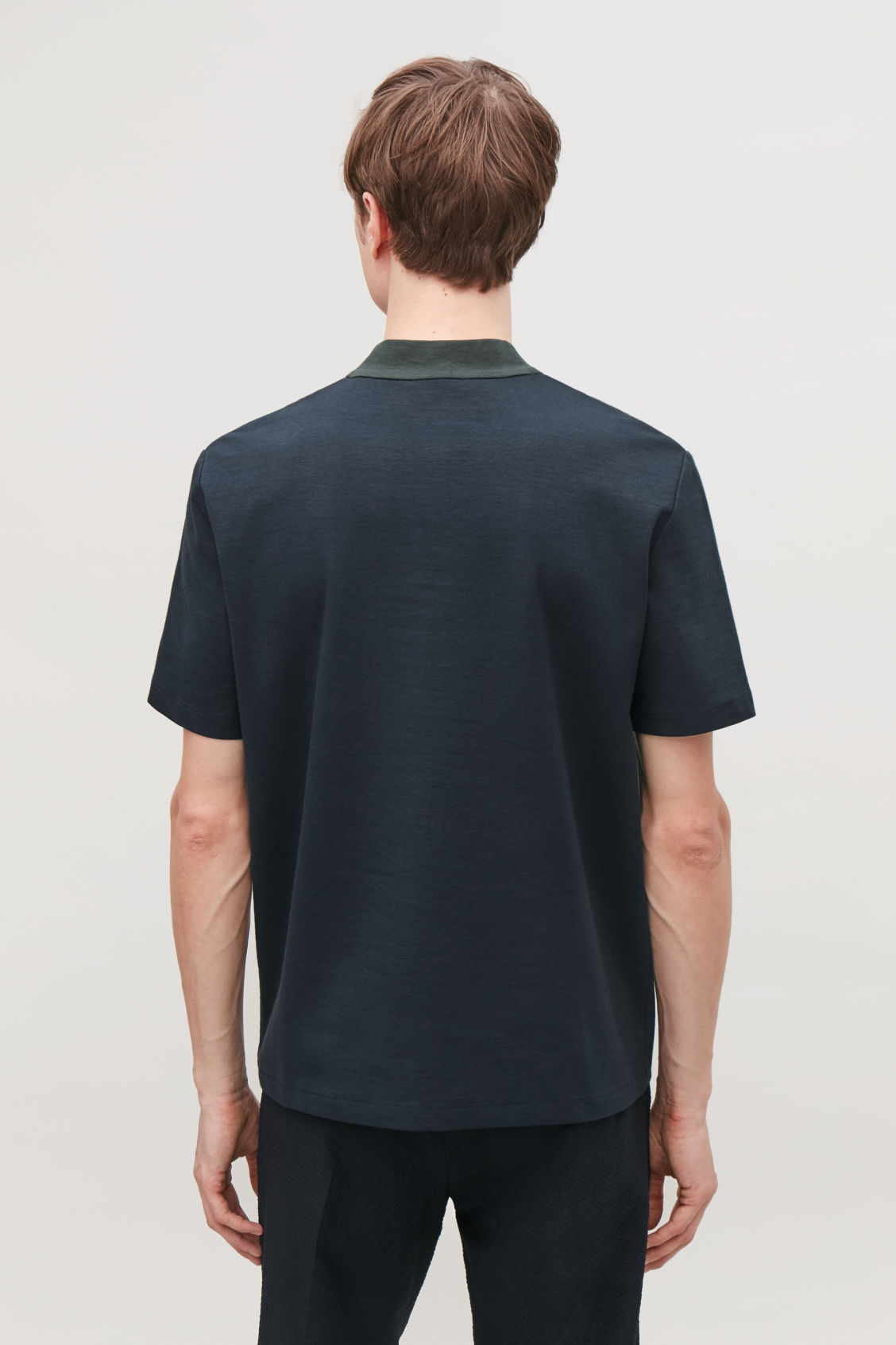 Model side image of Cos zipped mock neck t-shirt in blue