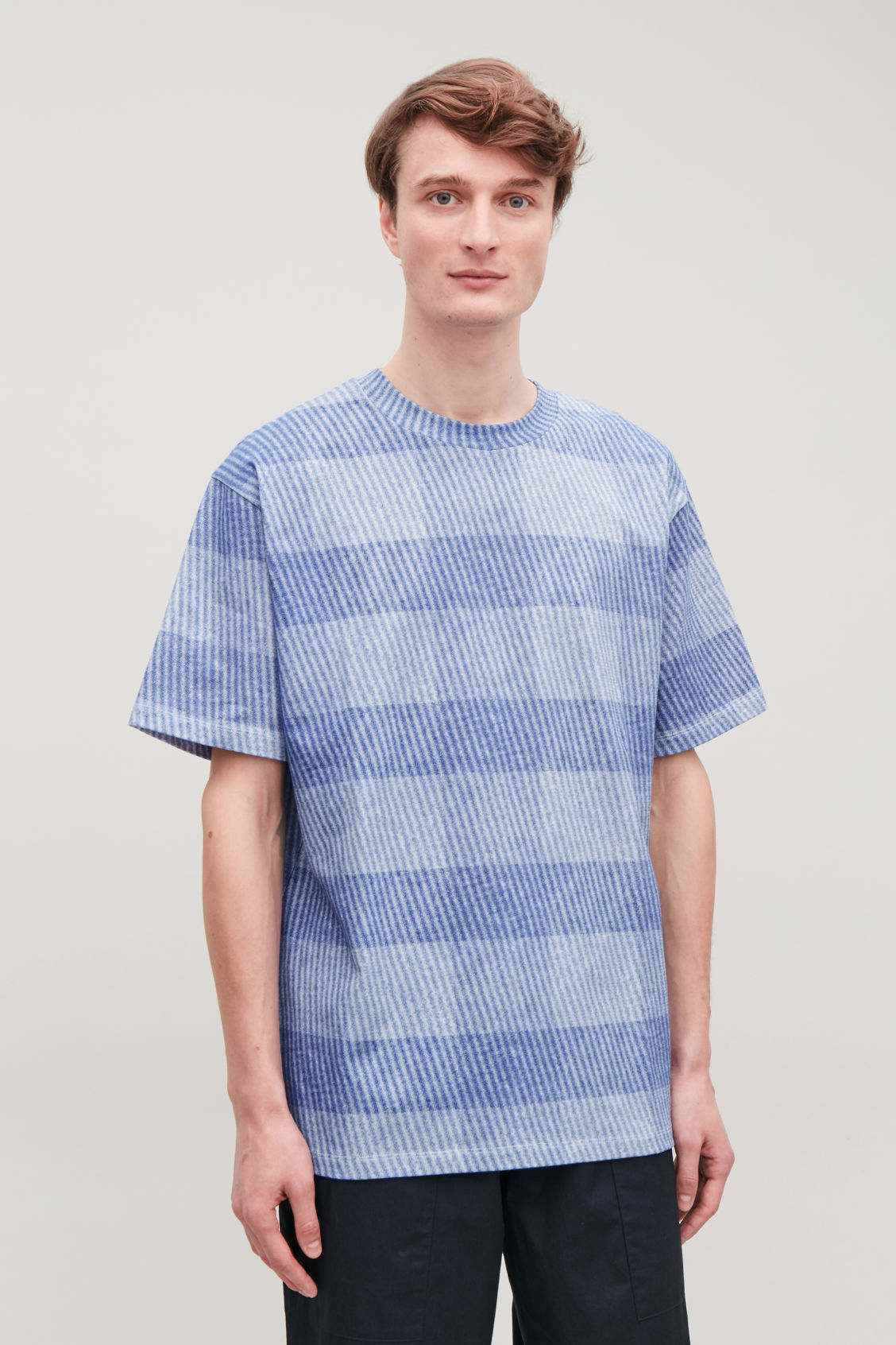Model side image of Cos light-print jersey t-shirt in blue