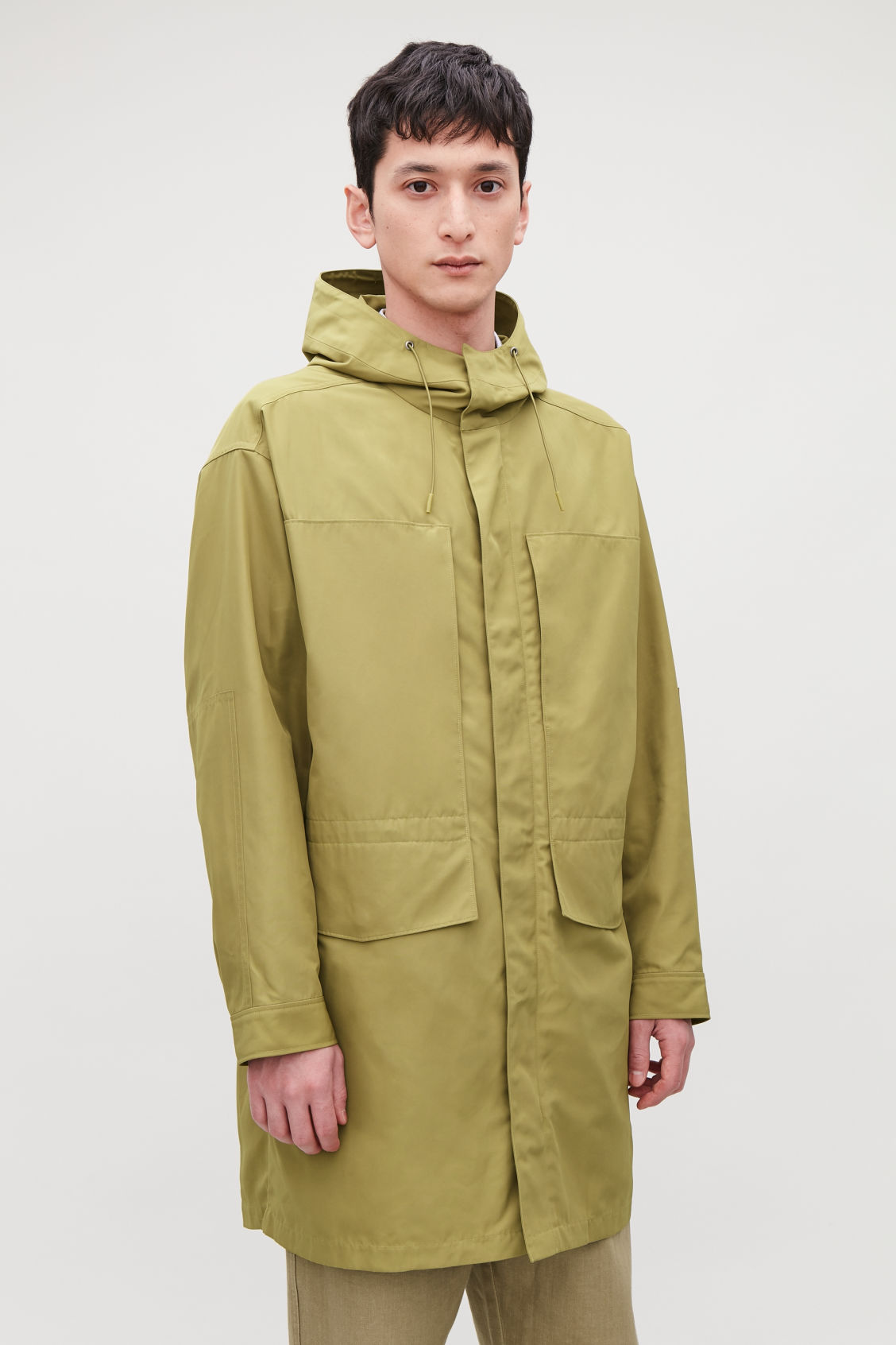 Model side image of Cos hooded nylon parka  in yellow