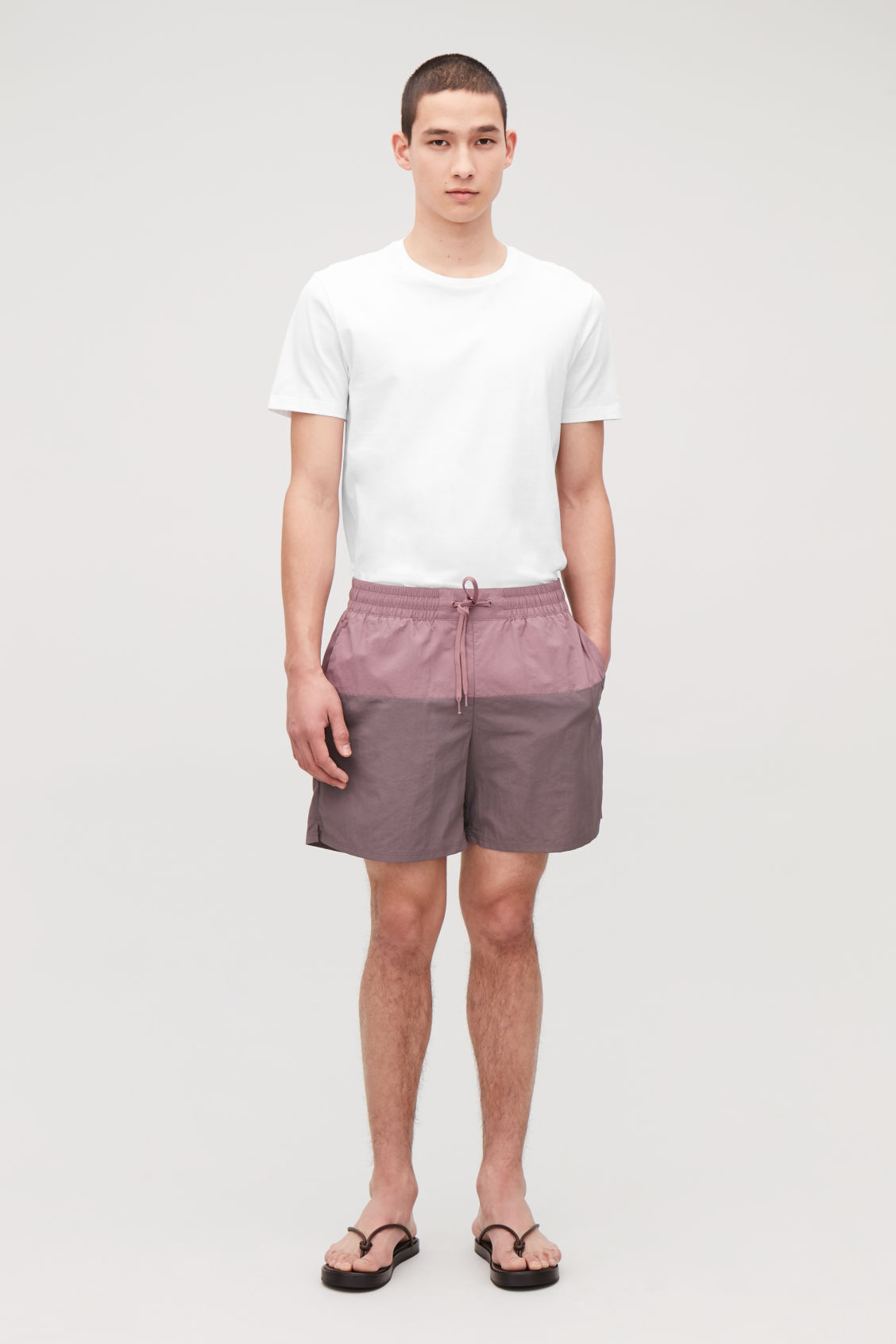 Model front image of Cos colour-block swim shorts in purple