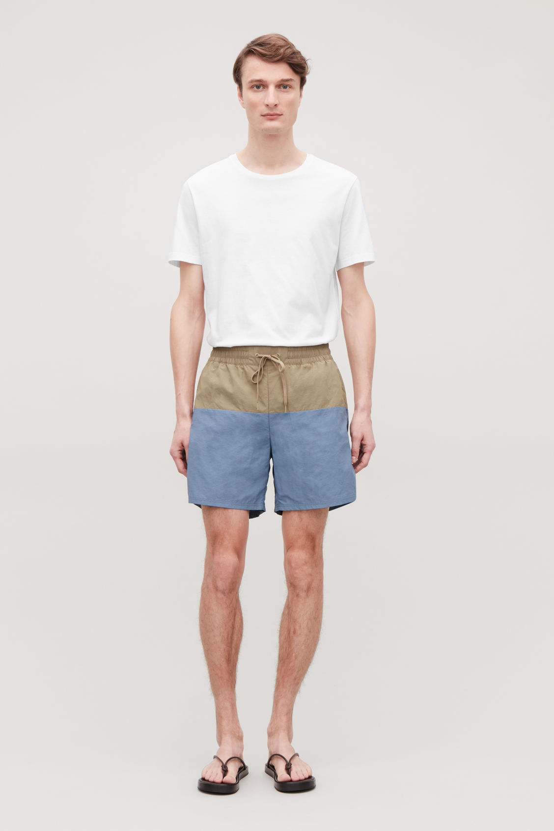 Model front image of Cos colour-block swim shorts in blue