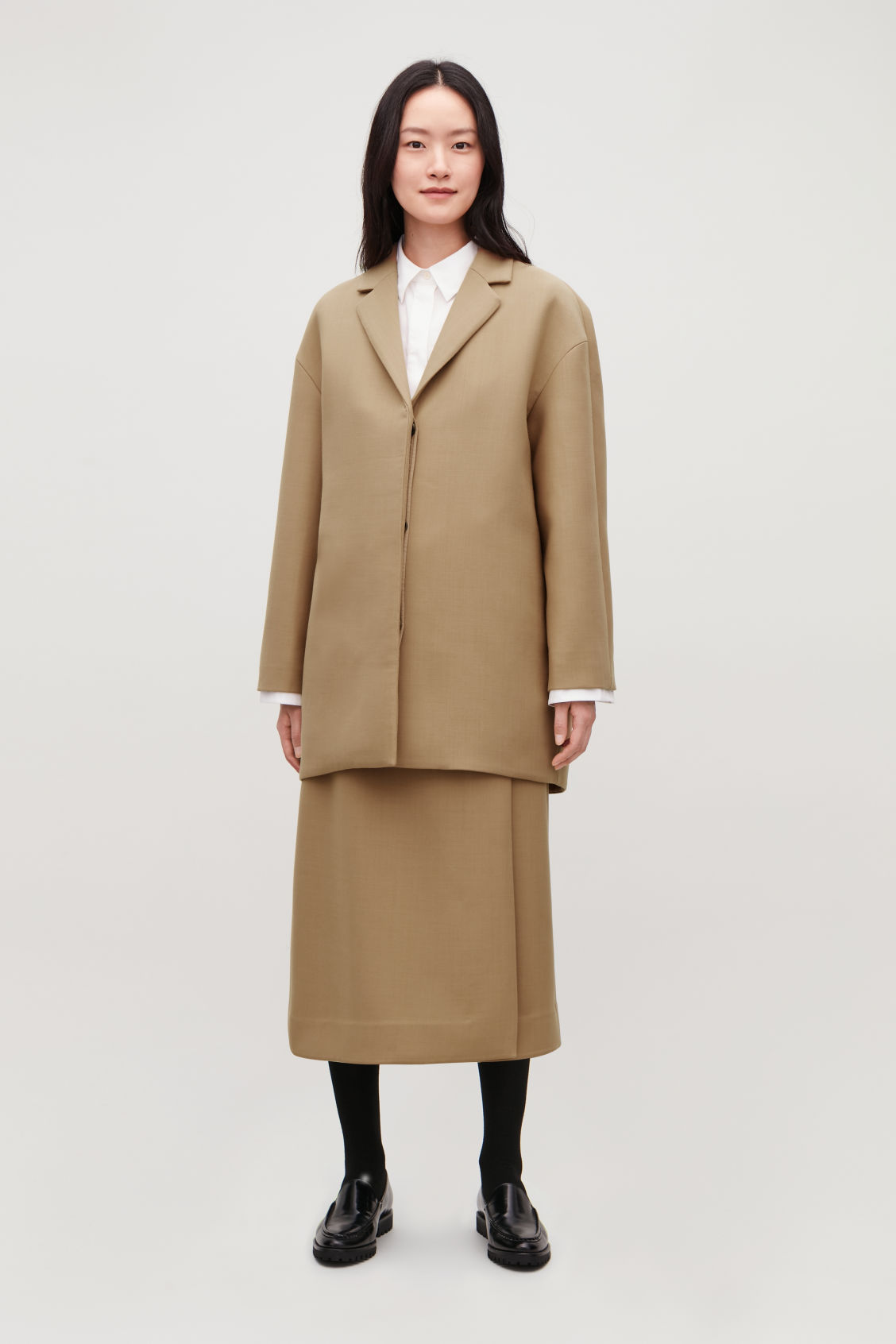 Model front image of Cos wool-blend cocoon coat in beige