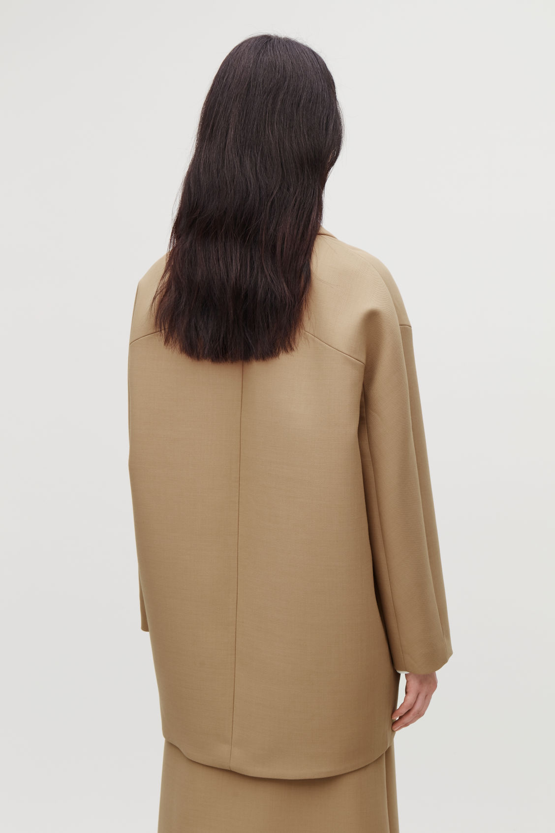 Model side image of Cos wool-blend cocoon coat in beige