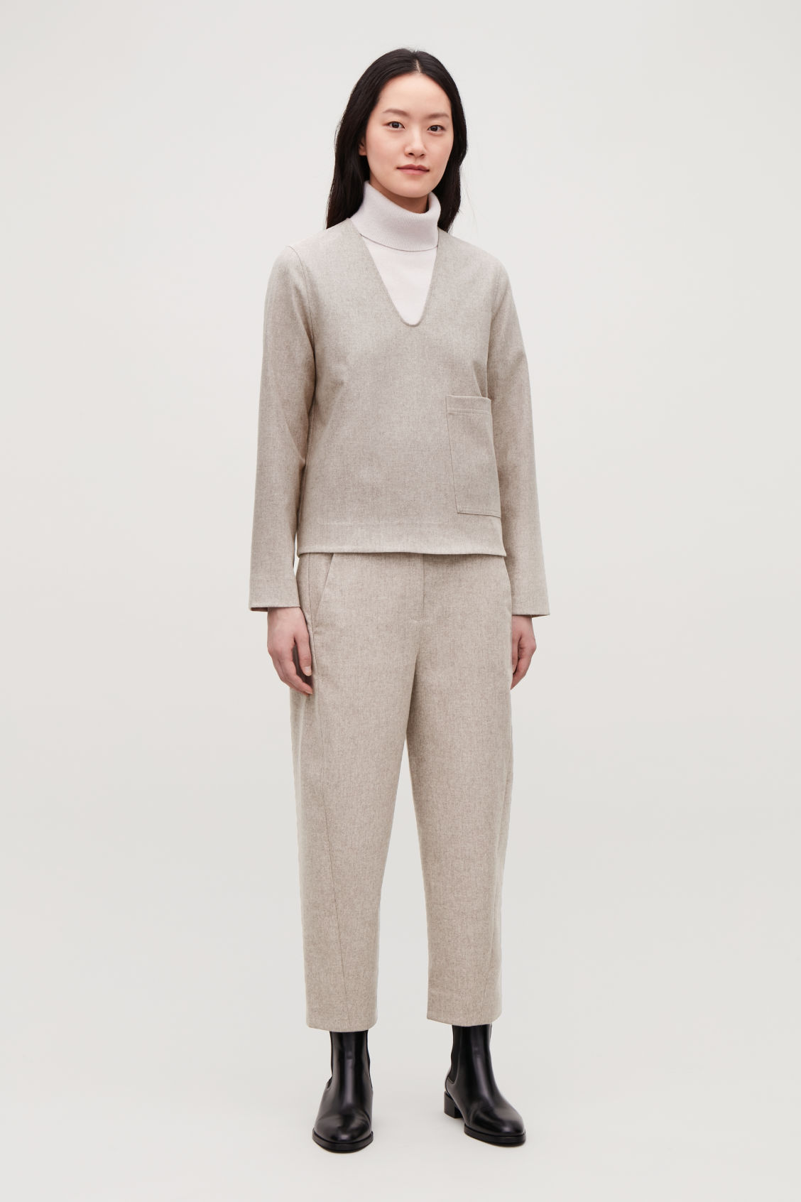 Model front image of Cos wool twisted-seam trousers in beige