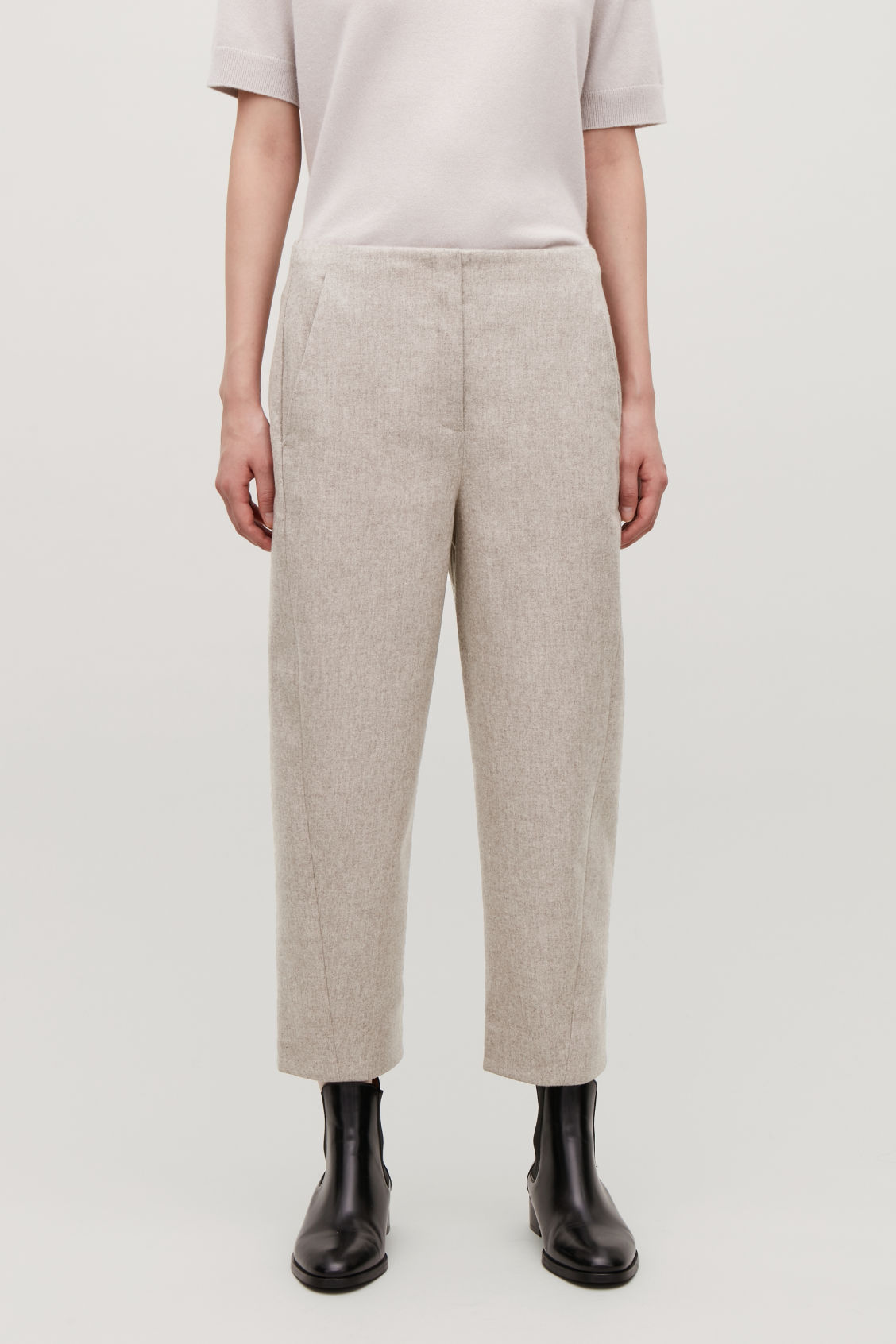 Model side image of Cos wool twisted-seam trousers in beige