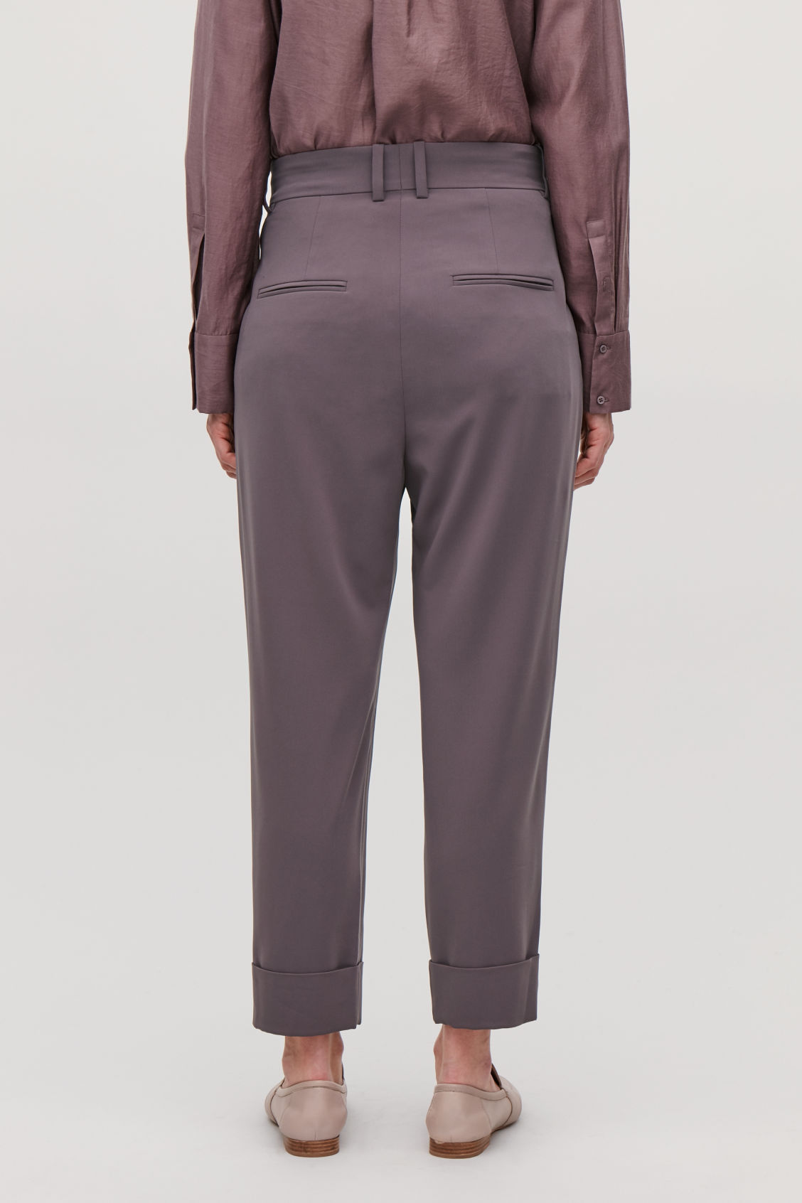 Model side image of Cos relaxed pleated trousers in purple