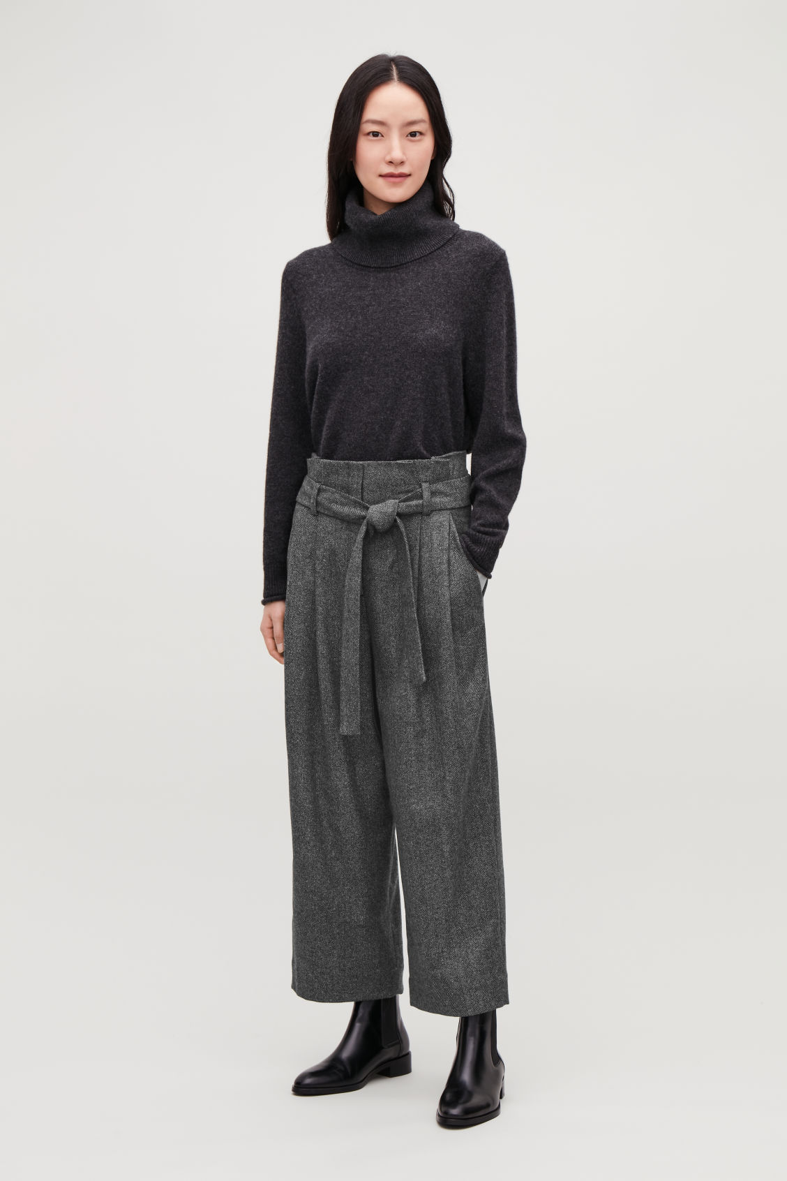 Model front image of Cos belted herringbone wool trousers in grey