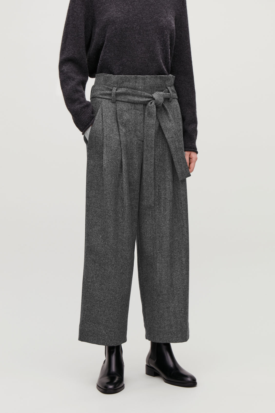 Model side image of Cos belted herringbone wool trousers in grey