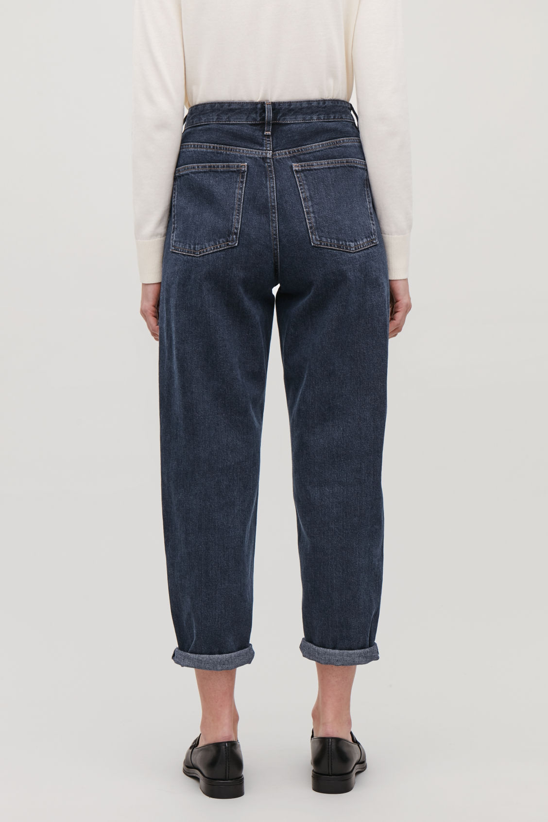 Model side image of Cos tapered leg jeans in blue
