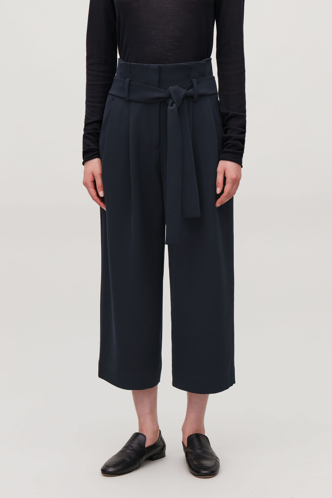 Model side image of Cos belted paperbag culottes in blue