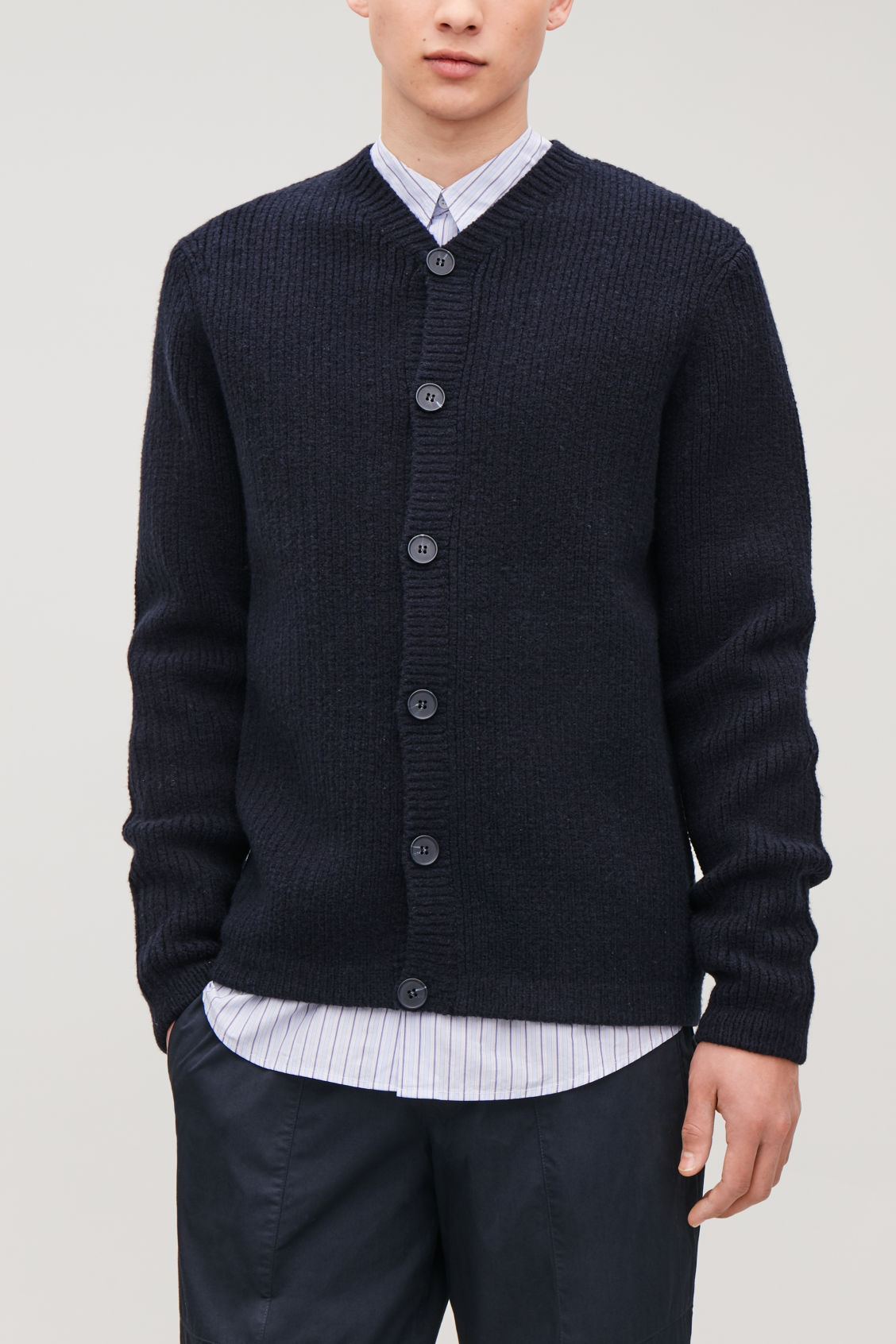 Model side image of Cos thick-wool v-neck cardigan in blue