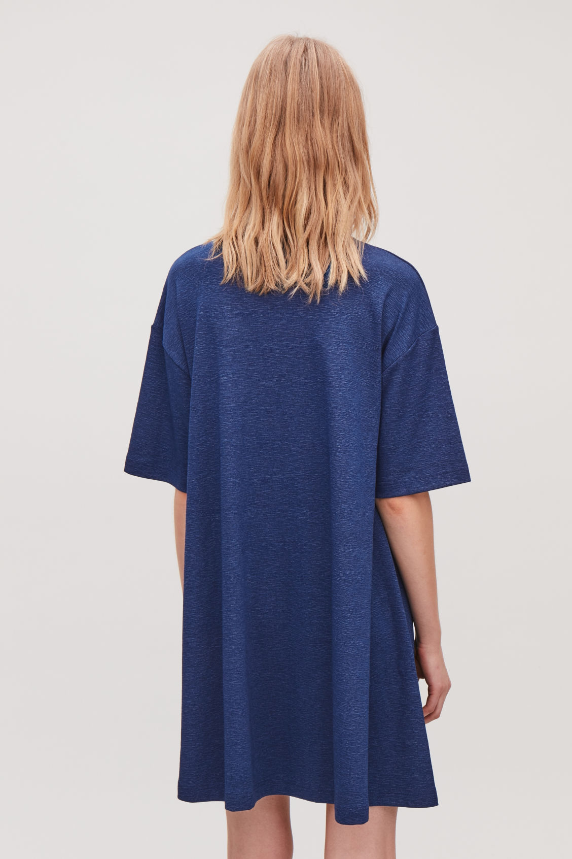 Model side image of Cos casual jersey a-line dress in blue