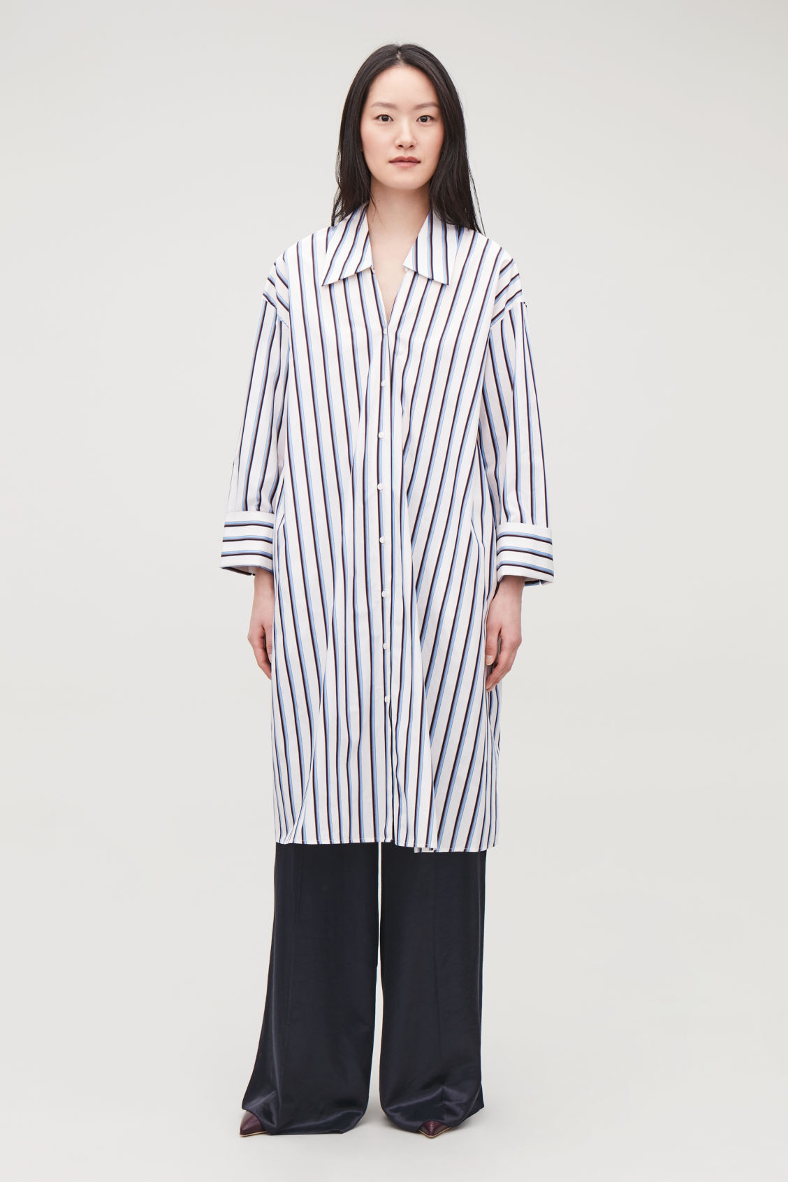0612ffbdf212 Model front image of Cos striped mid-length shirt dress in white