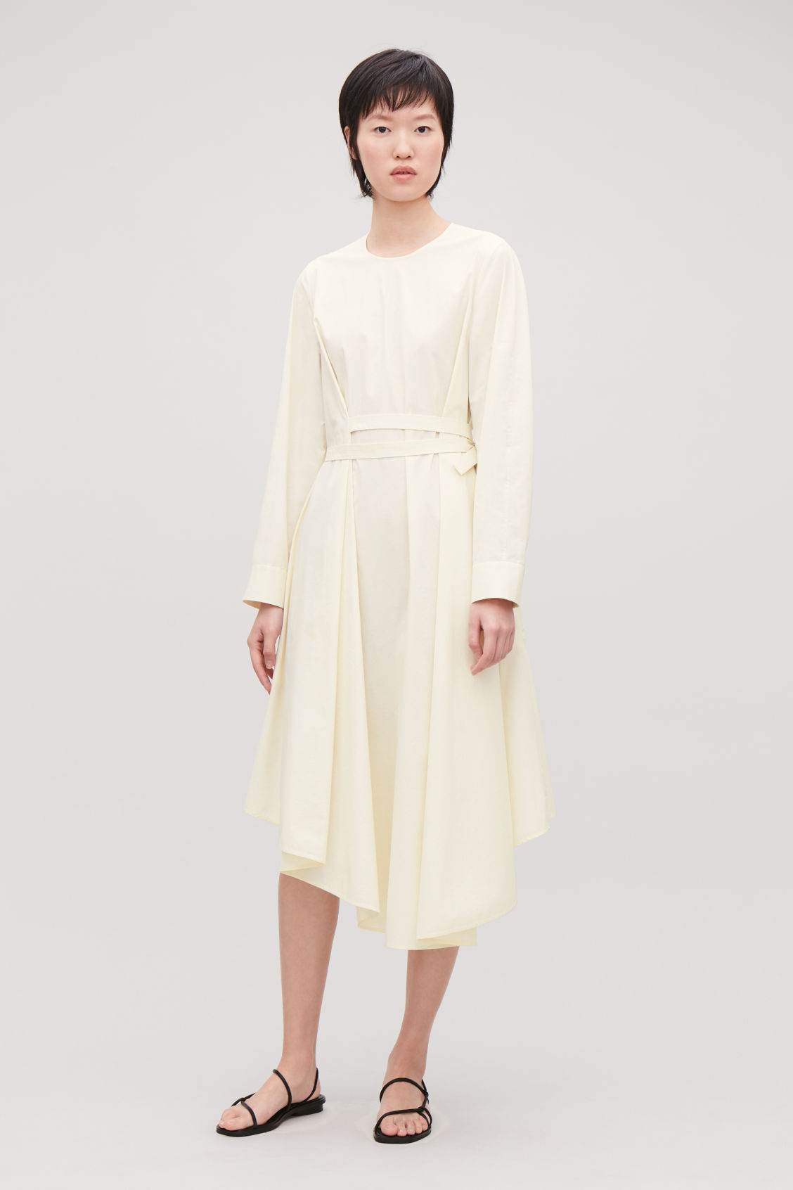 Model front image of Cos versatile long cotton dress in cream