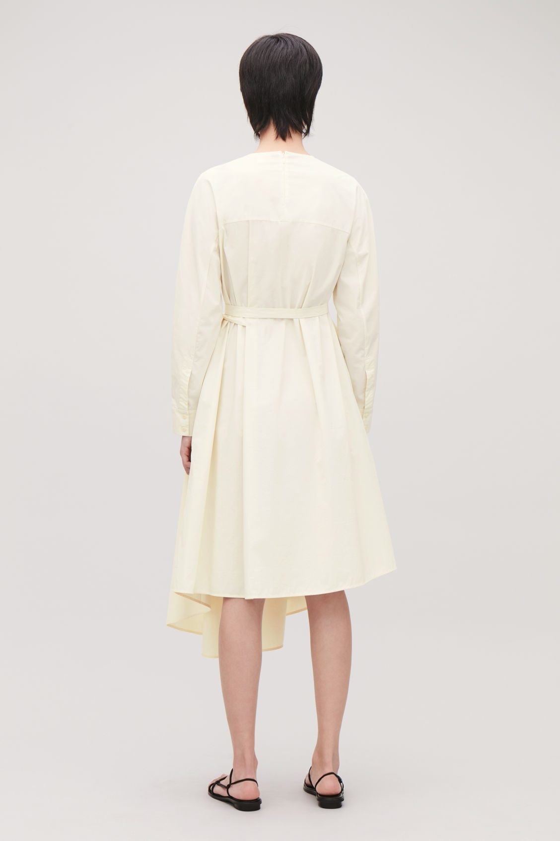 Model side image of Cos versatile long cotton dress in cream