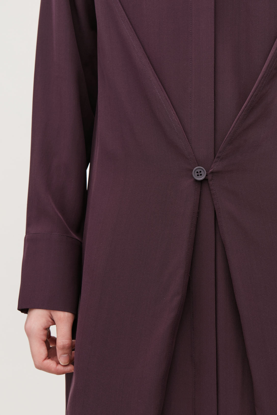 Model side image of Cos button-detailed silk shirt dress in burgundy