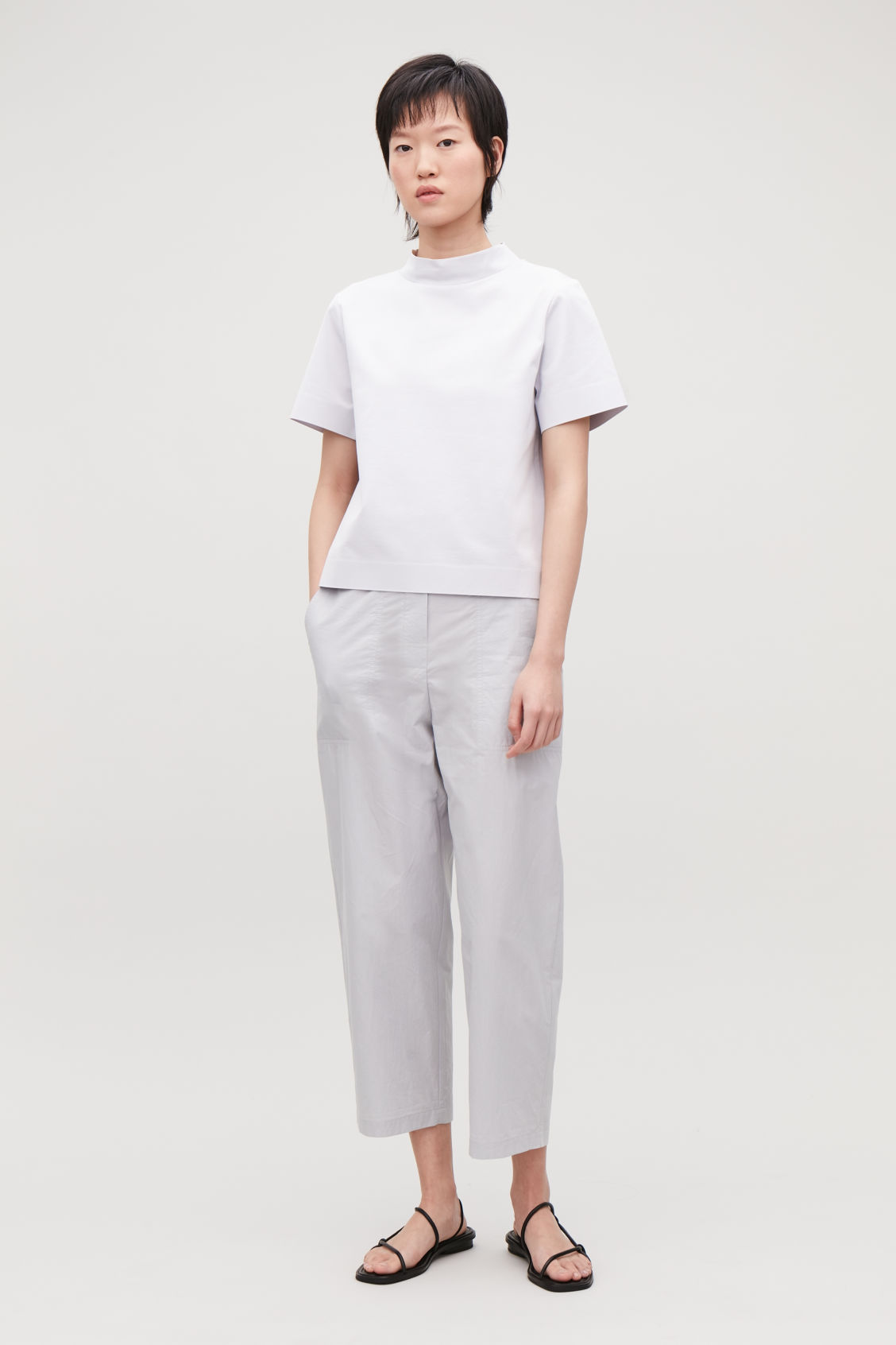 Model front image of Cos boxy mock-neck jersey top in grey