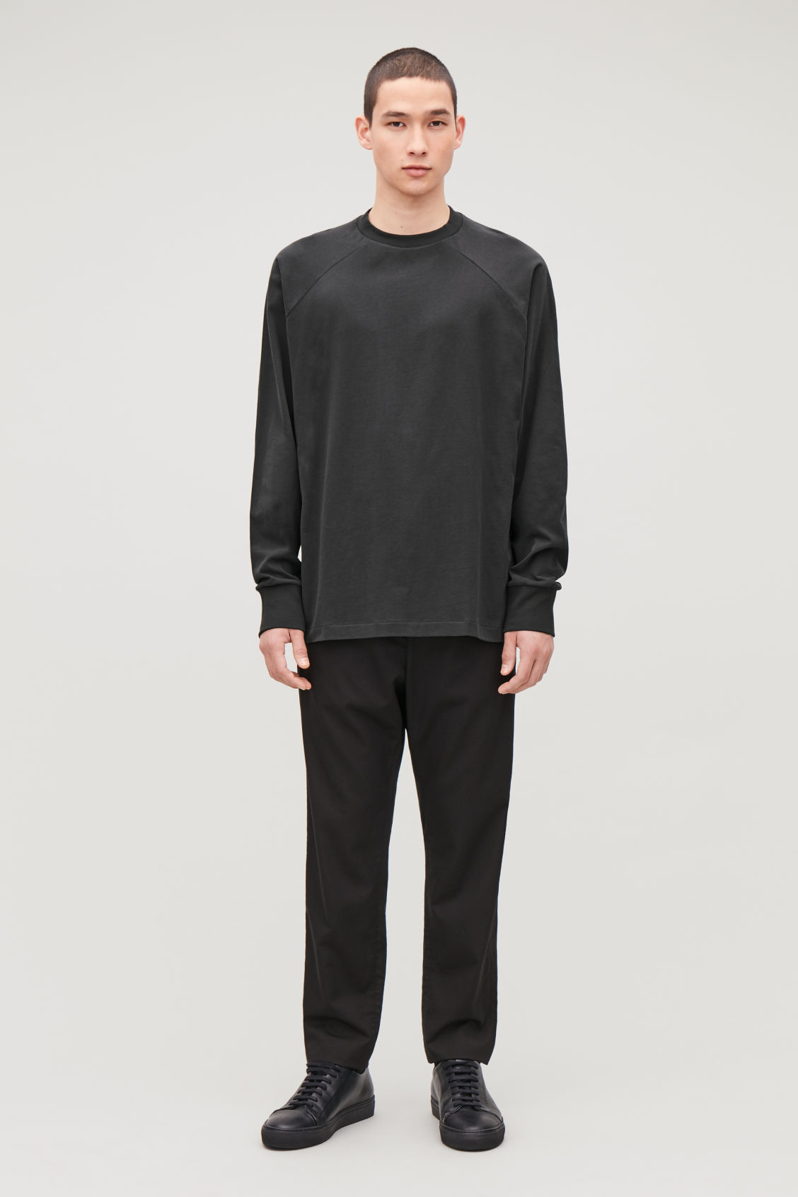 Model front image of Cos brushed long-sleeved sweatshirt in black