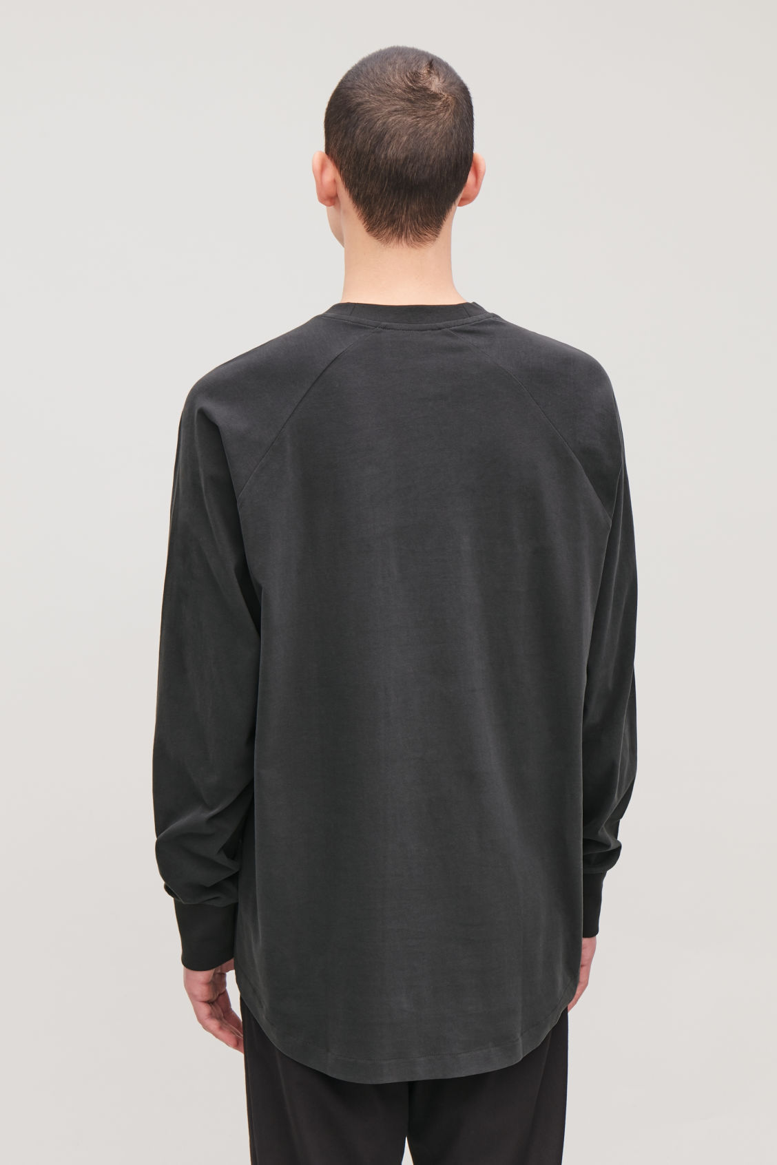 Model side image of Cos brushed long-sleeved sweatshirt in black