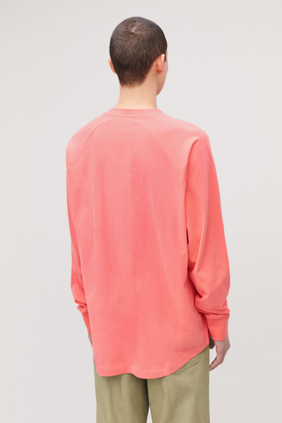 Model side image of Cos brushed long-sleeved sweatshirt in orange
