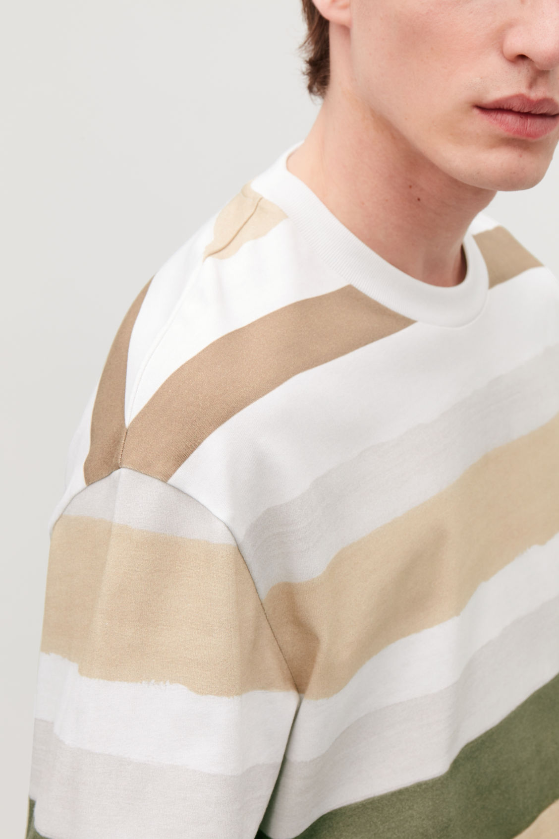 Model side image of Cos long-sleeved multi-striped t-shirt in blue
