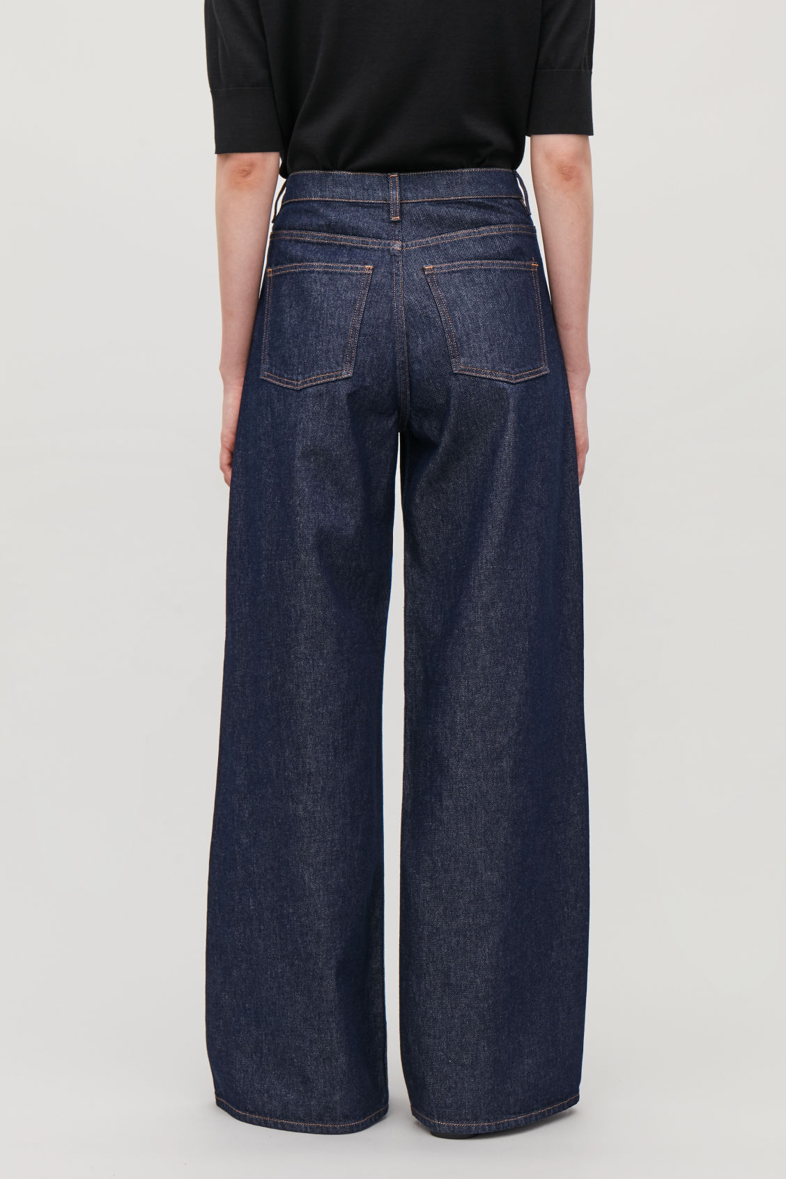 Model side image of Cos wide leg jeans in blue