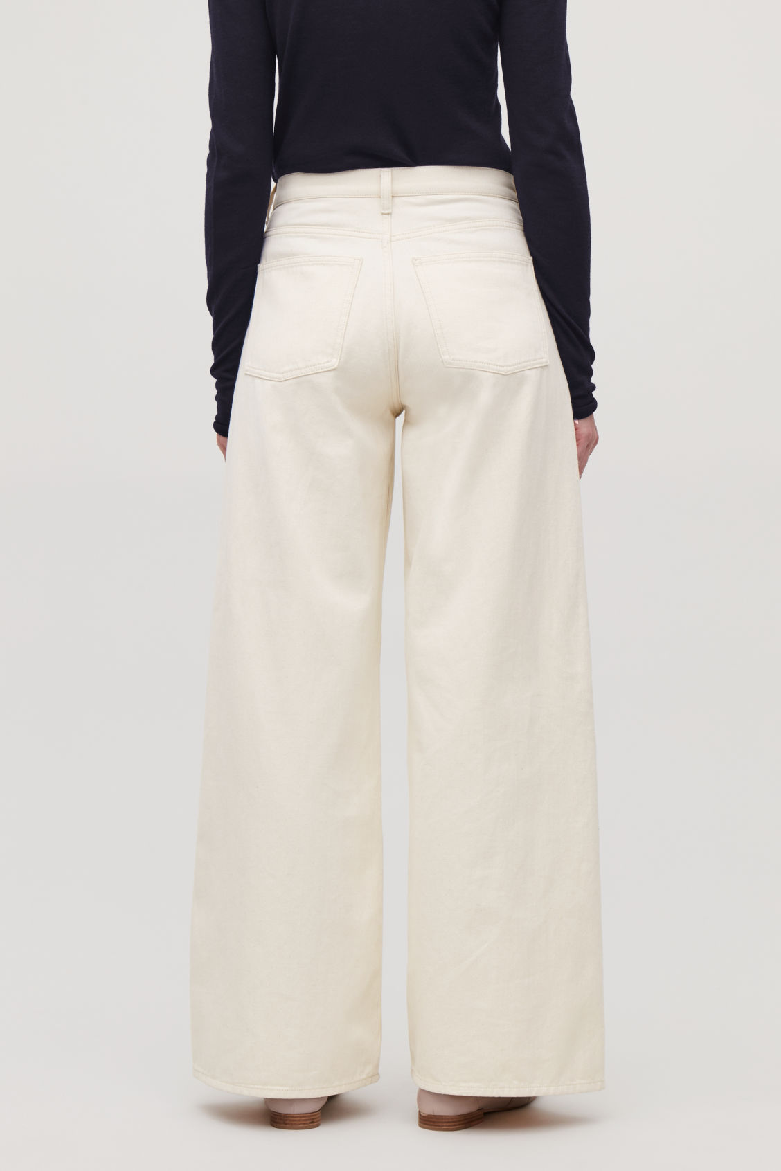 Model side image of Cos wide leg jeans in beige