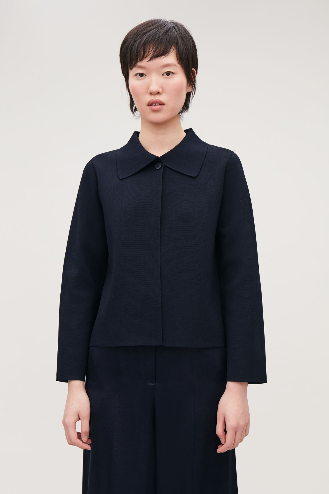 Model side image of Cos full-milano knit jacket in blue