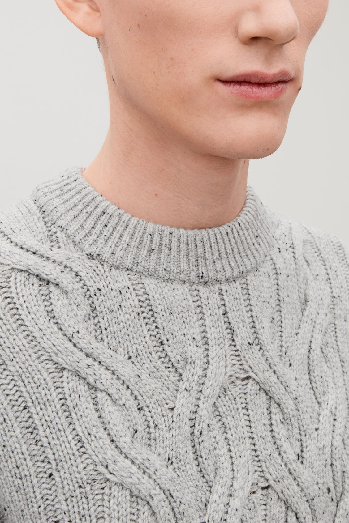 Model side image of Cos speckled cable-knit wool jumper in grey