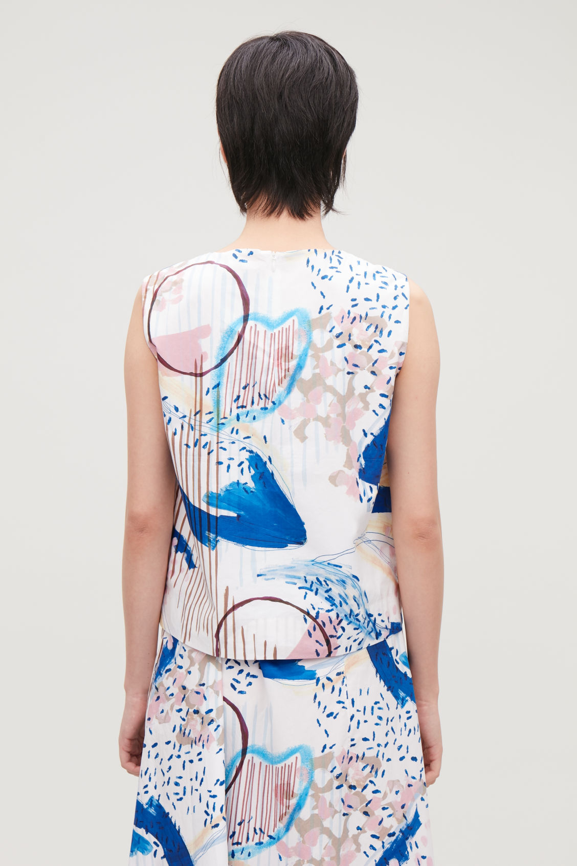 Model side image of Cos printed boxy sleeveless top  in white