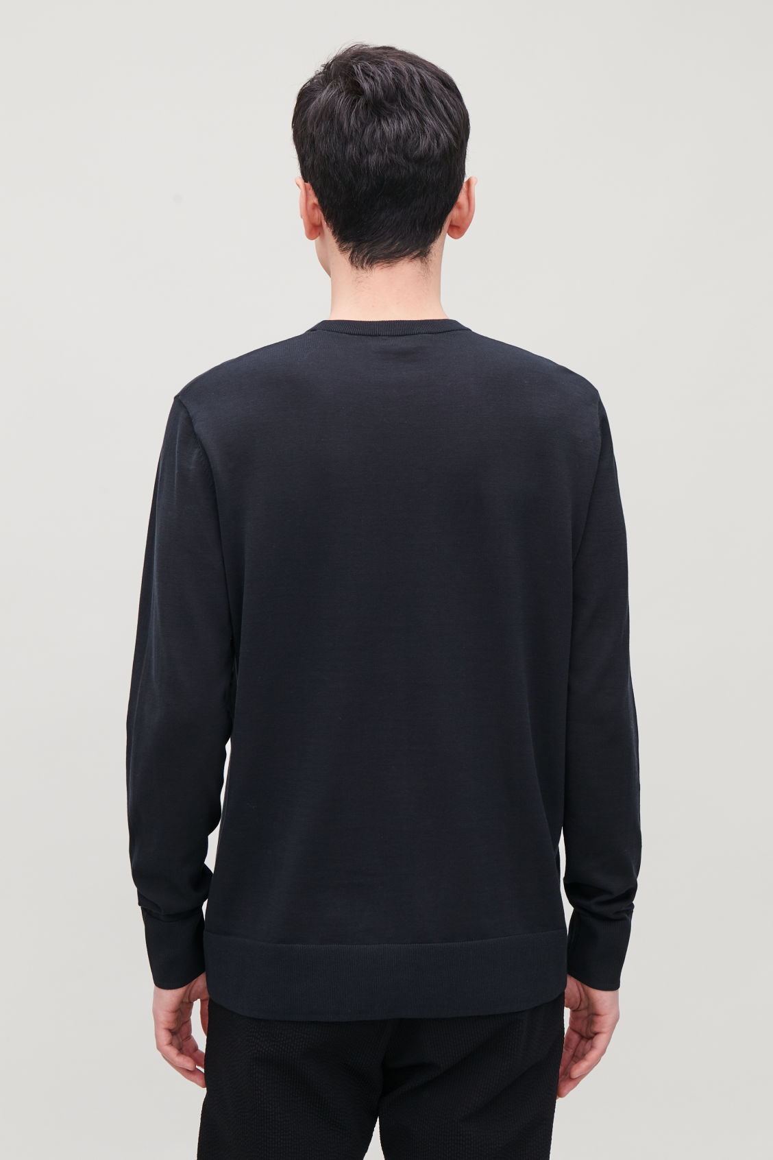 Model side image of Cos mercerised-cotton jumper in blue