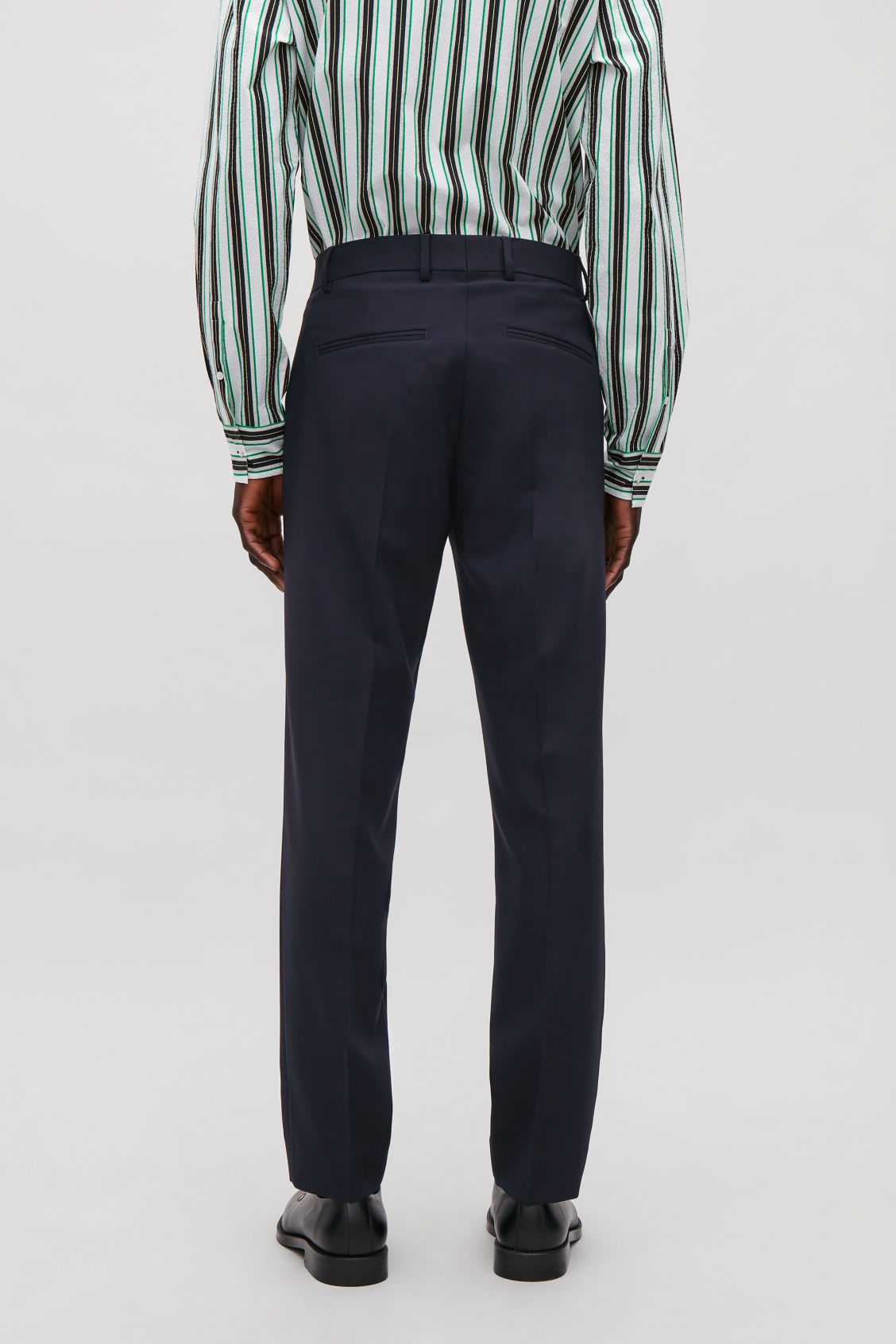 Model side image of Cos straight-leg tailored trousers in blue