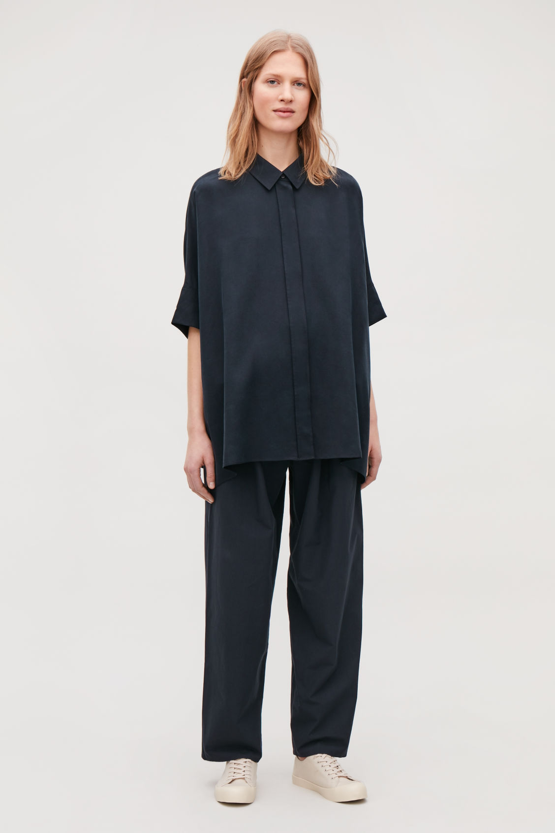 Model front image of Cos patch-pocket oversized shirt in blue