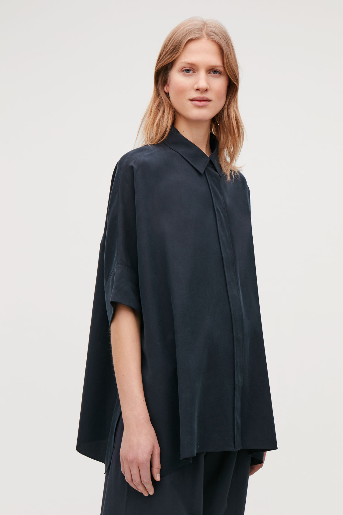 Model side image of Cos patch-pocket oversized shirt in blue