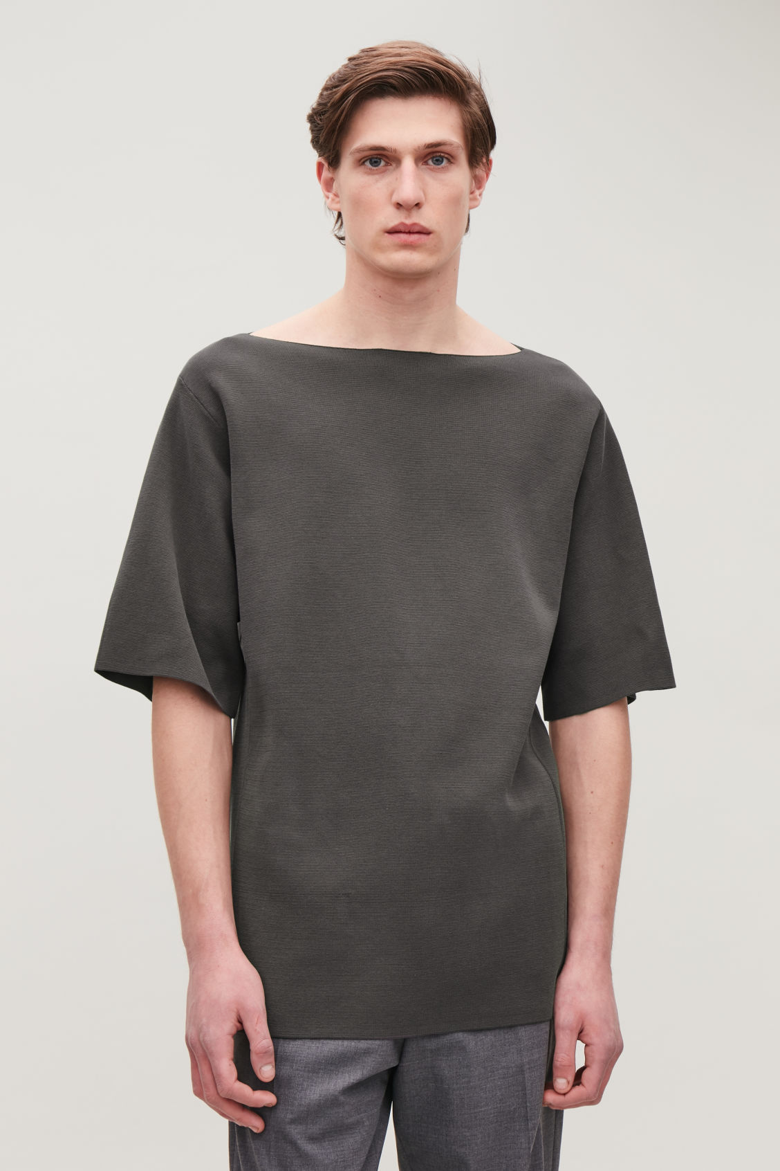Model side image of Cos boat-neck knitted top in grey