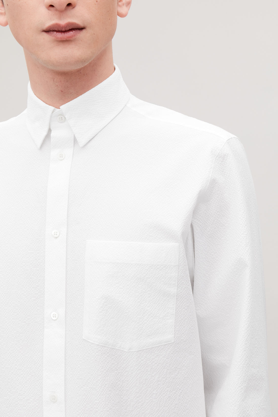 Model side image of Cos cotton-seersucker shirt  in white