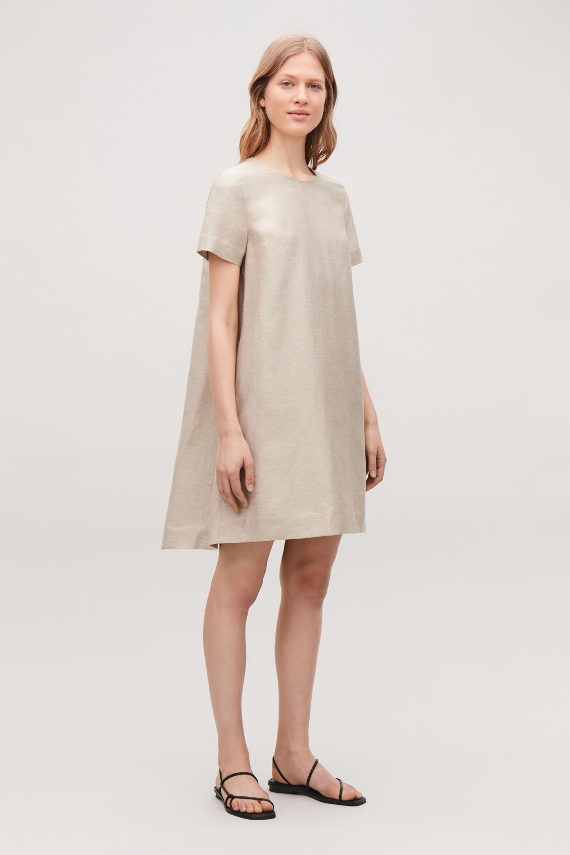 Model front image of Cos linen dress with pleated back in beige